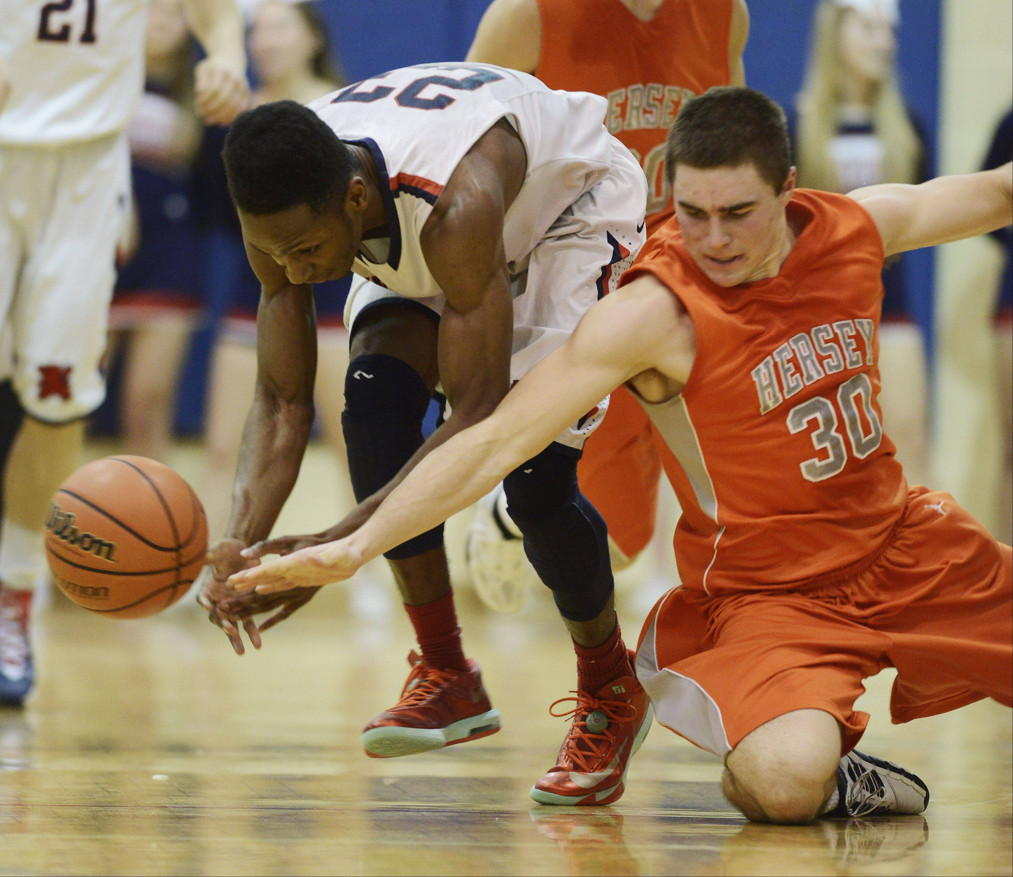 St. Viator's Ore Arogundade, left, and Heresy's Grant Burke eye the loose ball Wednesday in Arlington Heights.