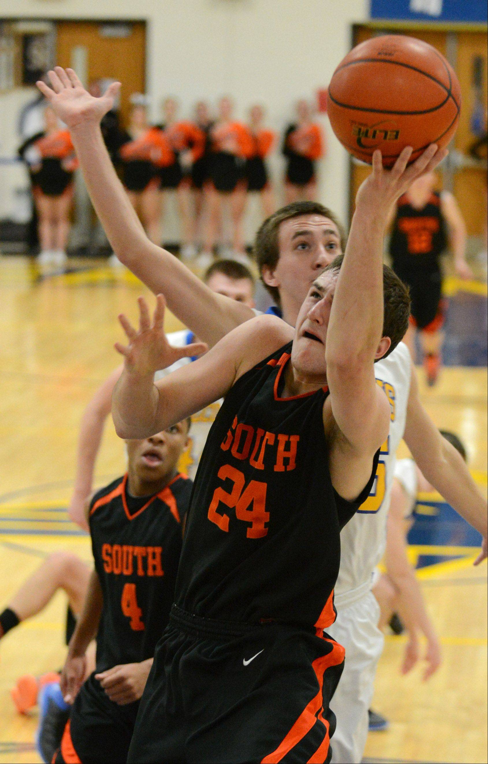 Wheaton Warrenville South's Matt Kienzle (24) takes a shot during Friday's game at Wheaton North.