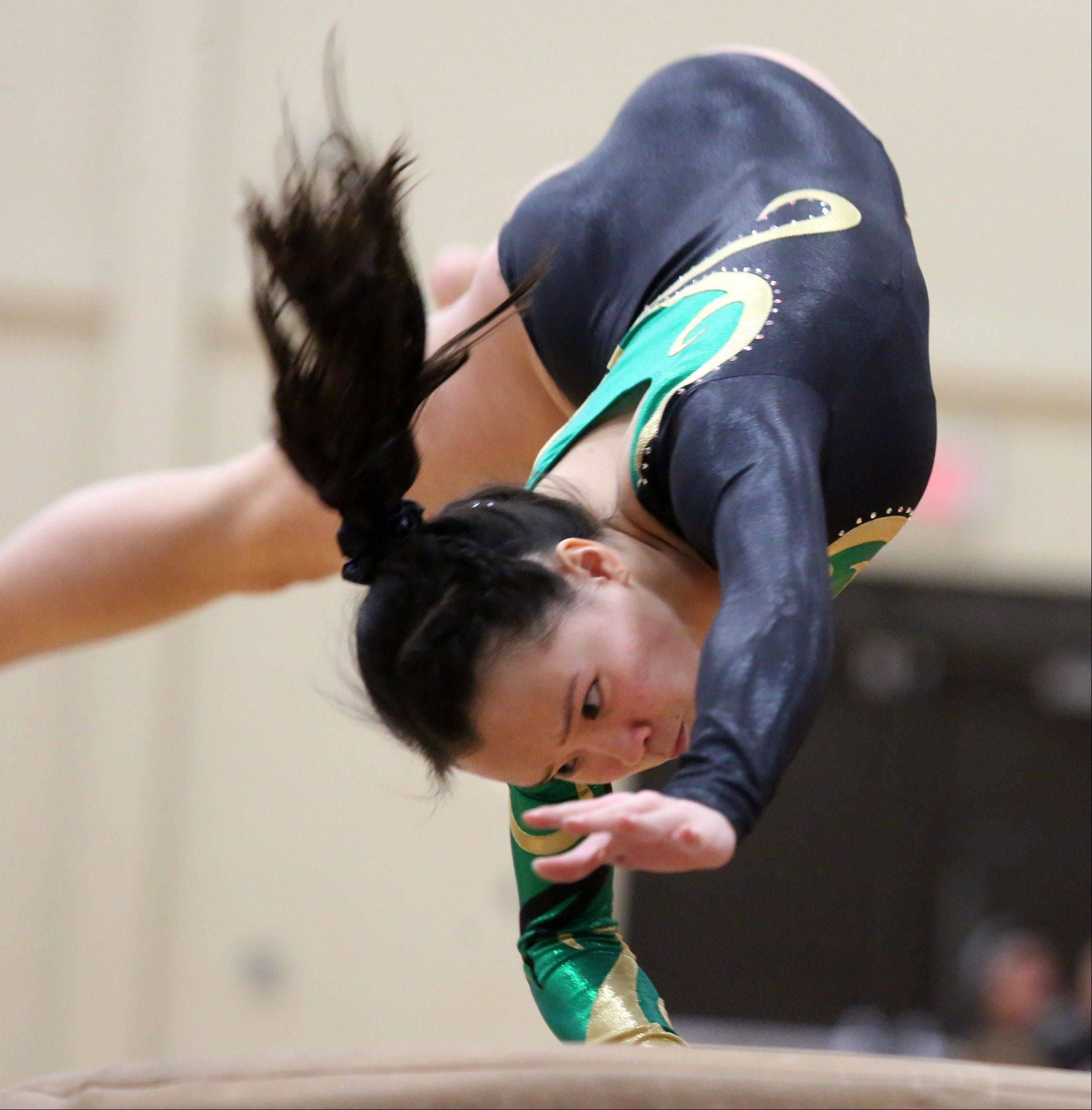 Stevenson's Elizabeth Shank competes on the vault during Friday's North Suburban Conference girls gymnastics meet in Libertyville.