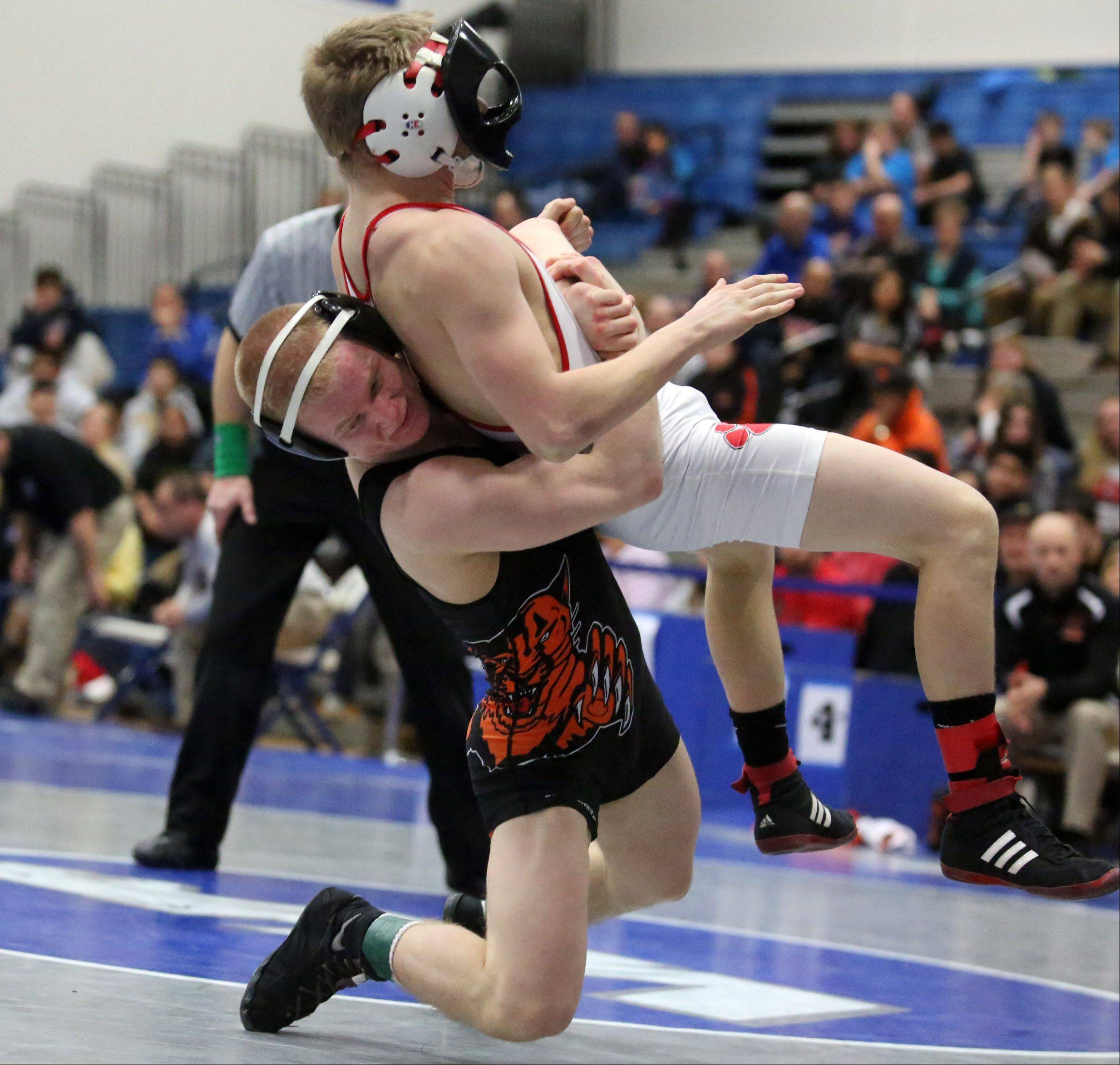 Libertyville's Steve Polakowski, left, wins the 126-pound final match against Grant's Noah Drabek at Saturday's North Suburban Conference wrestling meet in Vernon Hills.