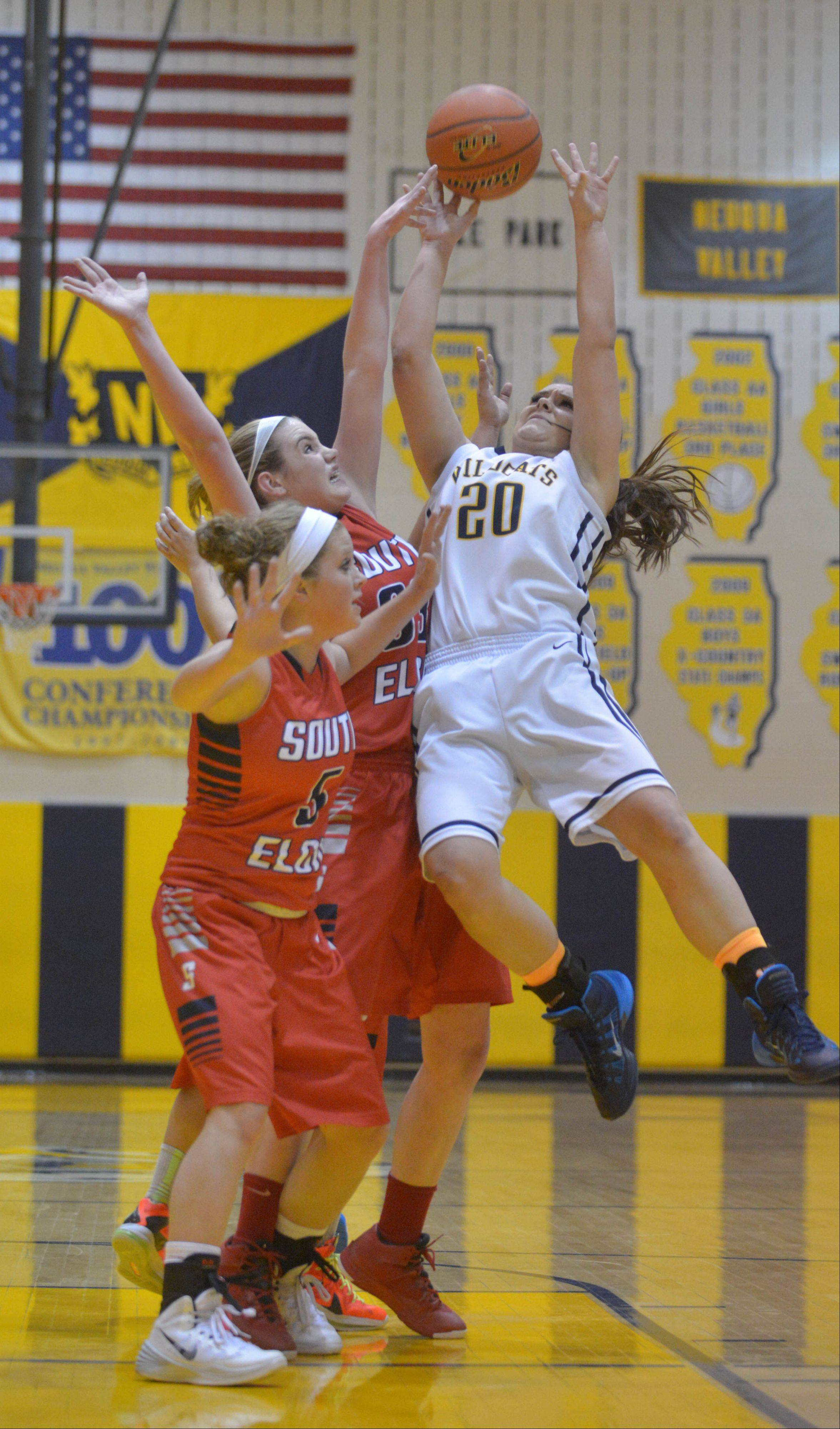 South Elgin's Anna Tracy and Mackie Kelleher go for a rebound with Neuqua Valley's Niki Lazar during Wednesday's game.
