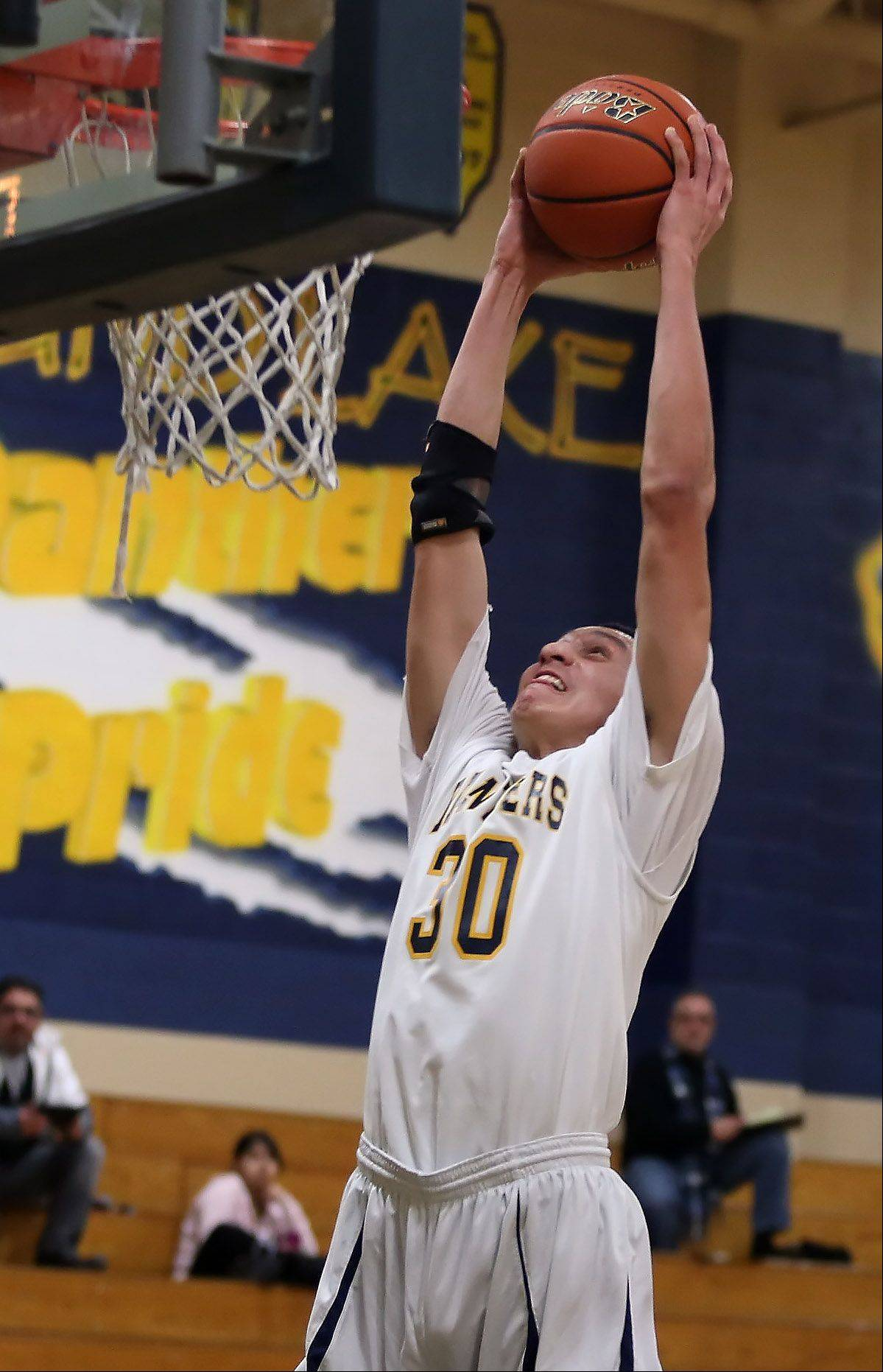 Round Lake's Mateusz Lopez dunks the ball during Thursday's game against Northtown Academy in Round Lake.