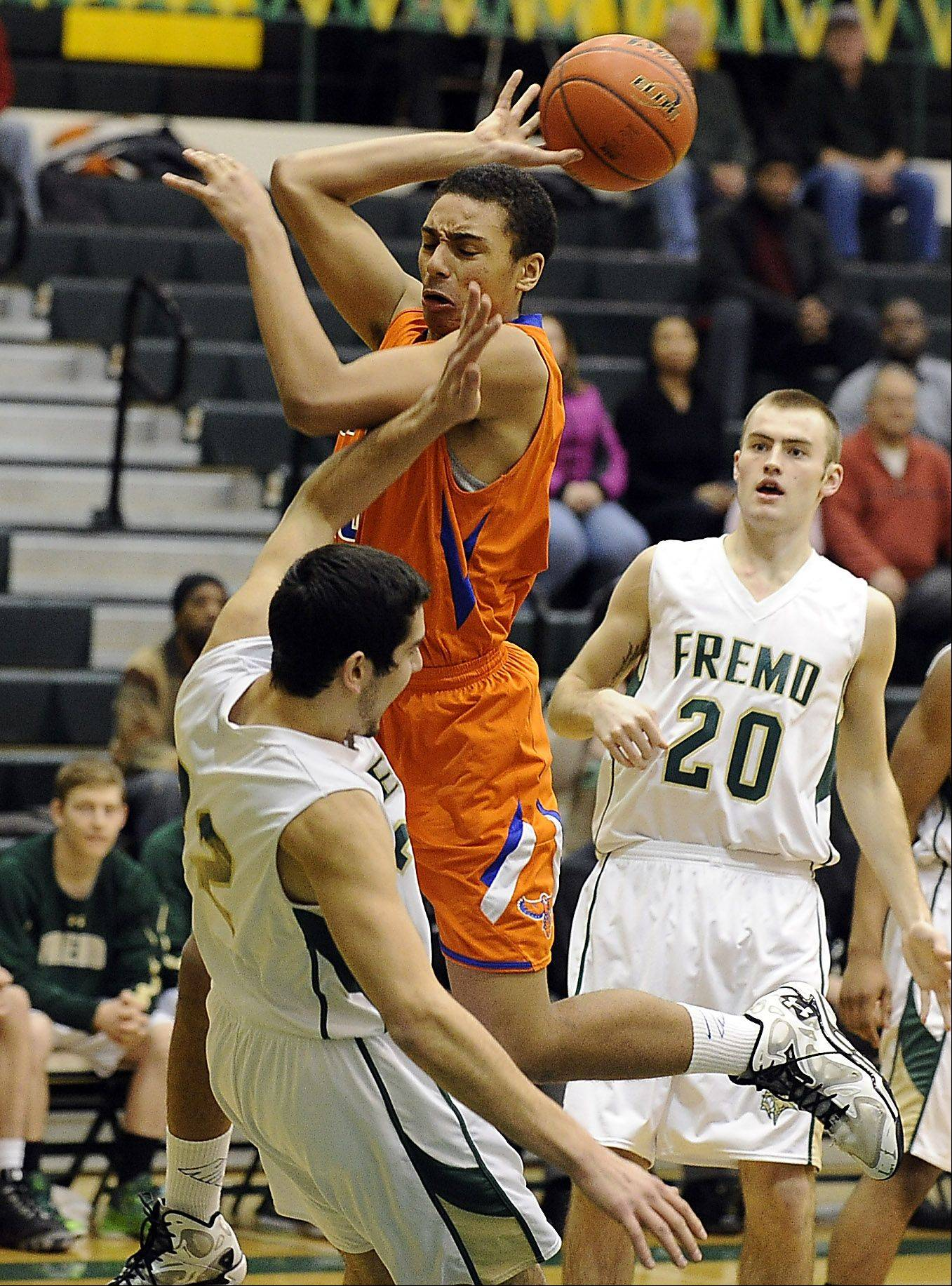 Hoffman Estates' Jordan Robinson loses control of the ball as Fremd's Matthew Ochoa defends during Friday's game.
