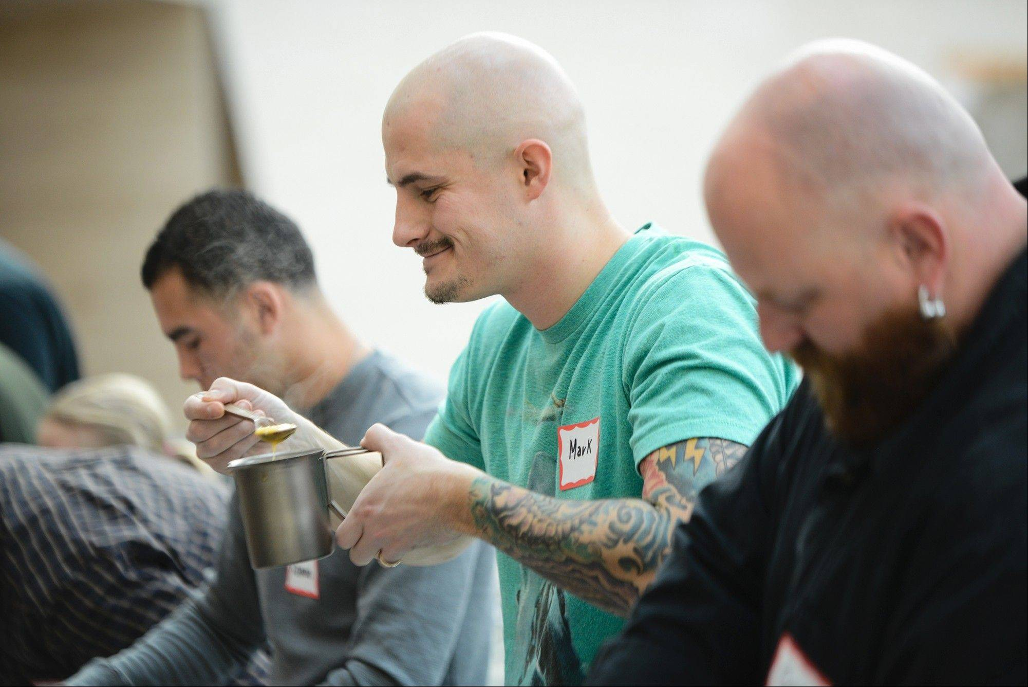 Mark Pike, 32, of Fredericksburg, Va., tastes his dish for the second annual Meal Ready-To-Eat/MRE cook-off Saturday at the National Museum of the Marine Corps in Triangle, Va.