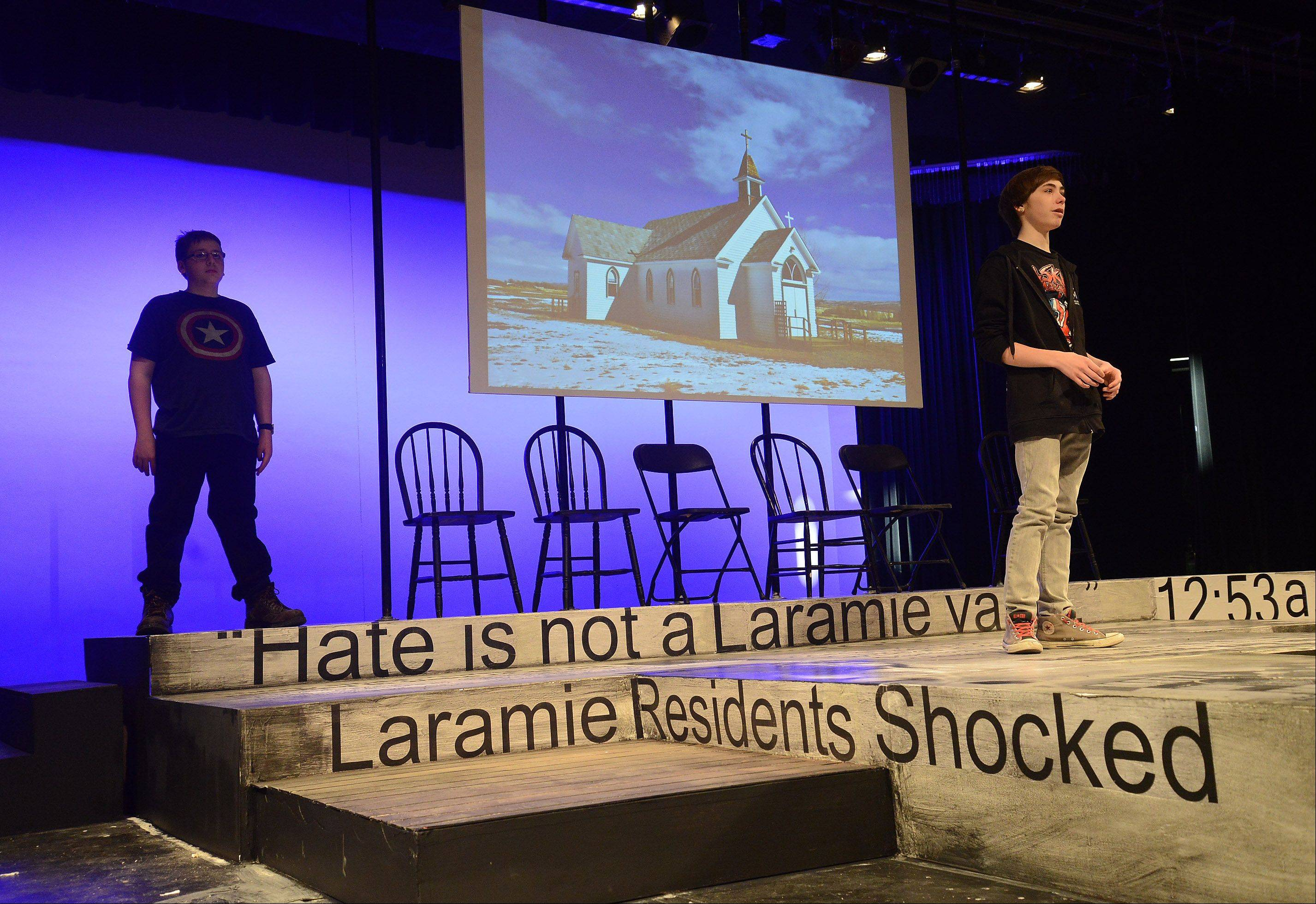 "Rolling Meadows High School students Seamus Lenihan, left, and Kenny Garrison rehearse for their upcoming performance in ""The Laramie Project."" The play tells the story of Matthew Shepard, a gay college student murdered in Wyoming 15 years ago."