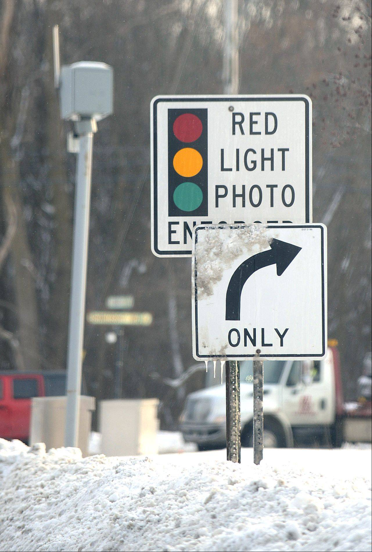 West Dundee leaders this week opted to keep using red light cameras, like the one here at southbound Boncosky Road and Route 31.