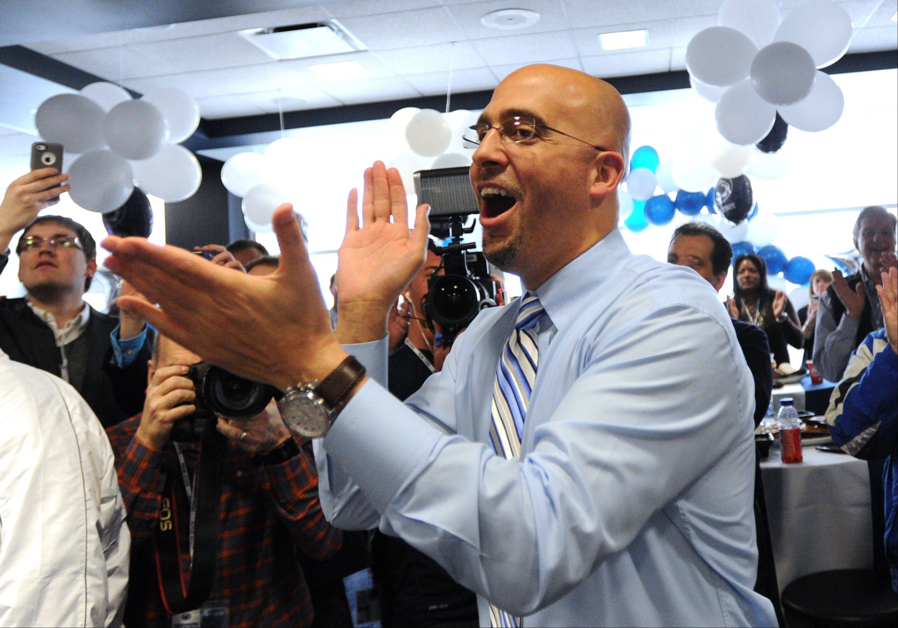 Penn State football coach James Franklin celebrates the announcement of a recruit committing to the school during national signing day Wednesday in State College, Pa.