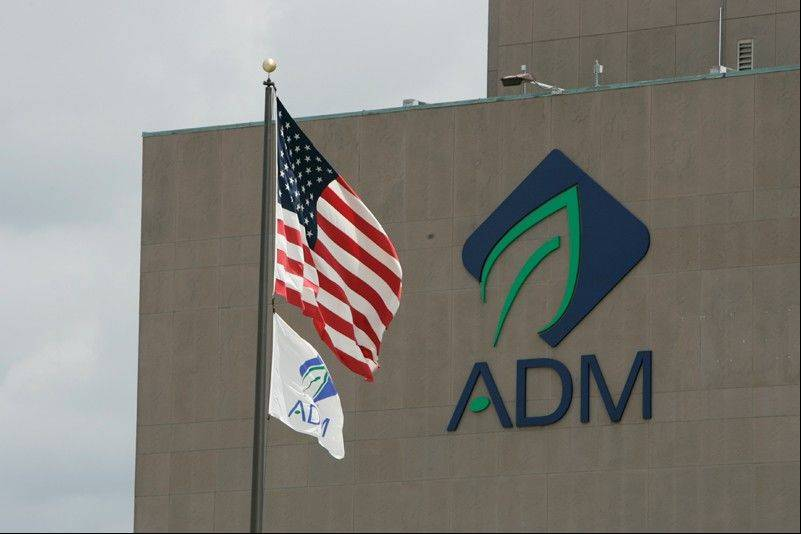 Decatur-based agribusiness giant Archer Daniels Midland Co. reported a 26.7 percent decline in its fourth-quarter earnings Tuesday on costs from its thwarted takeover of Australian grain handler GrainCorp.