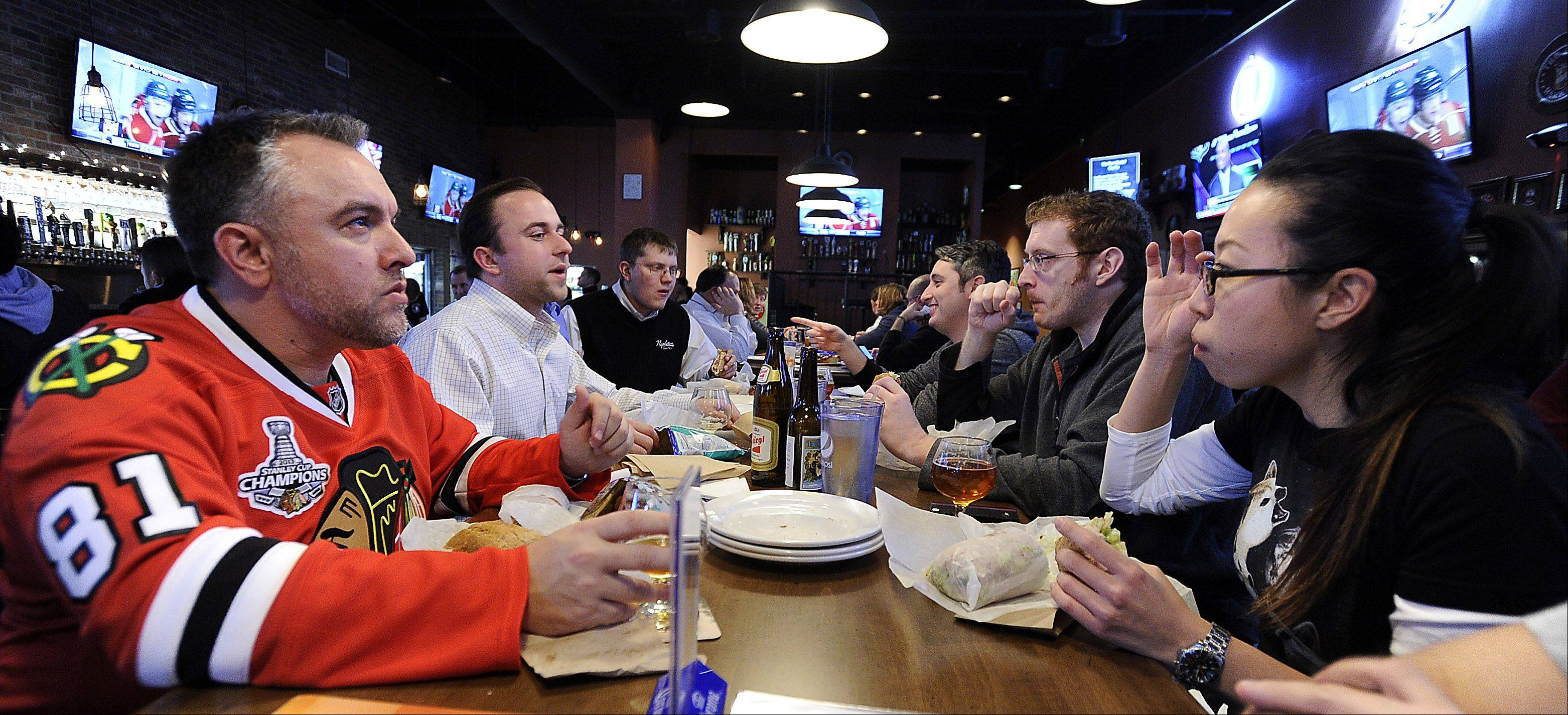 The Beer Market in Schaumburg draws hockey fans, like Jason Eberhardt of Elgin, left.