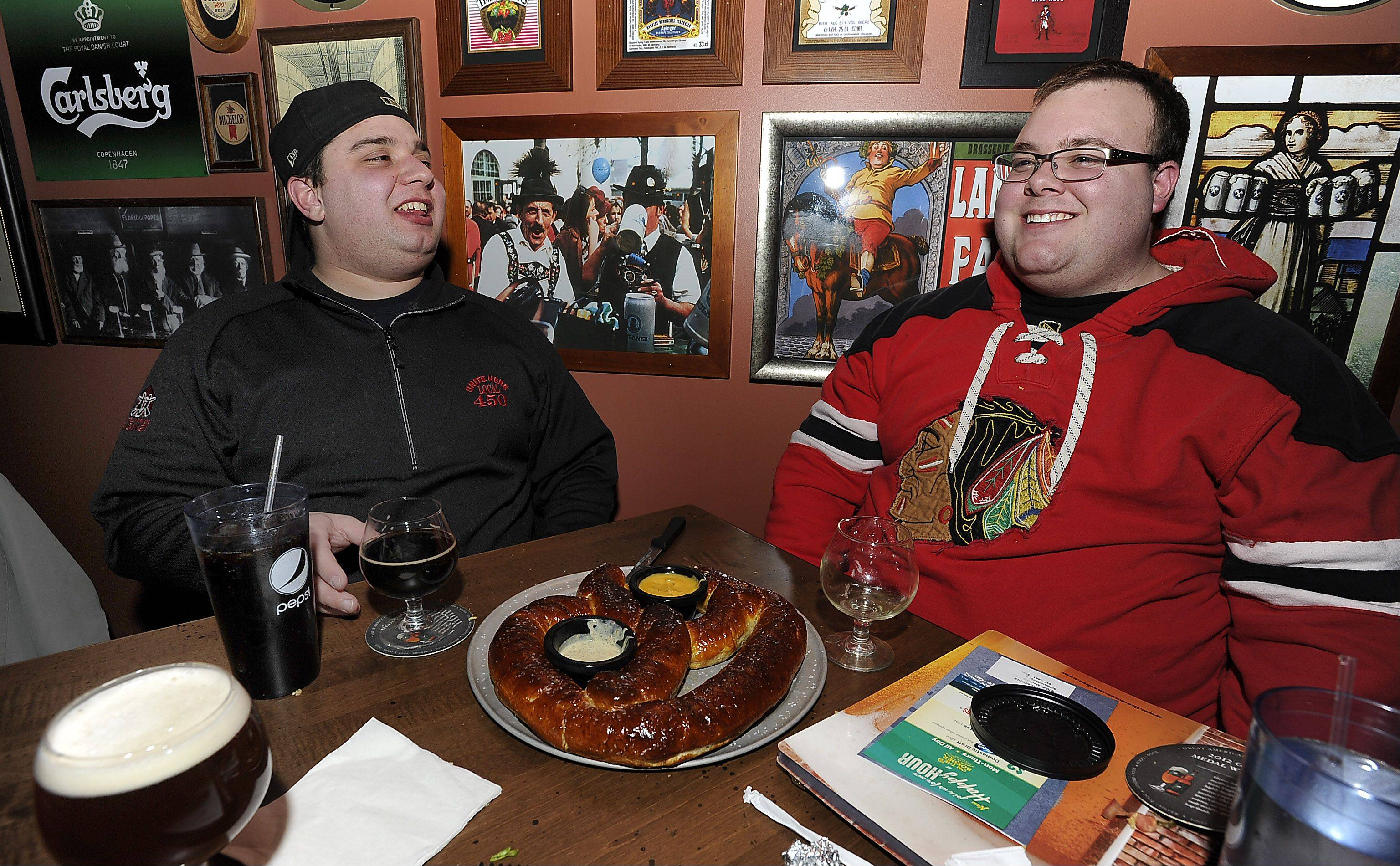 The Beer Market in Schaumburg draws hockey fans like Nick Mavraganis, left, of Elk Grove Village and Eric Fausher of Arlington Heights.