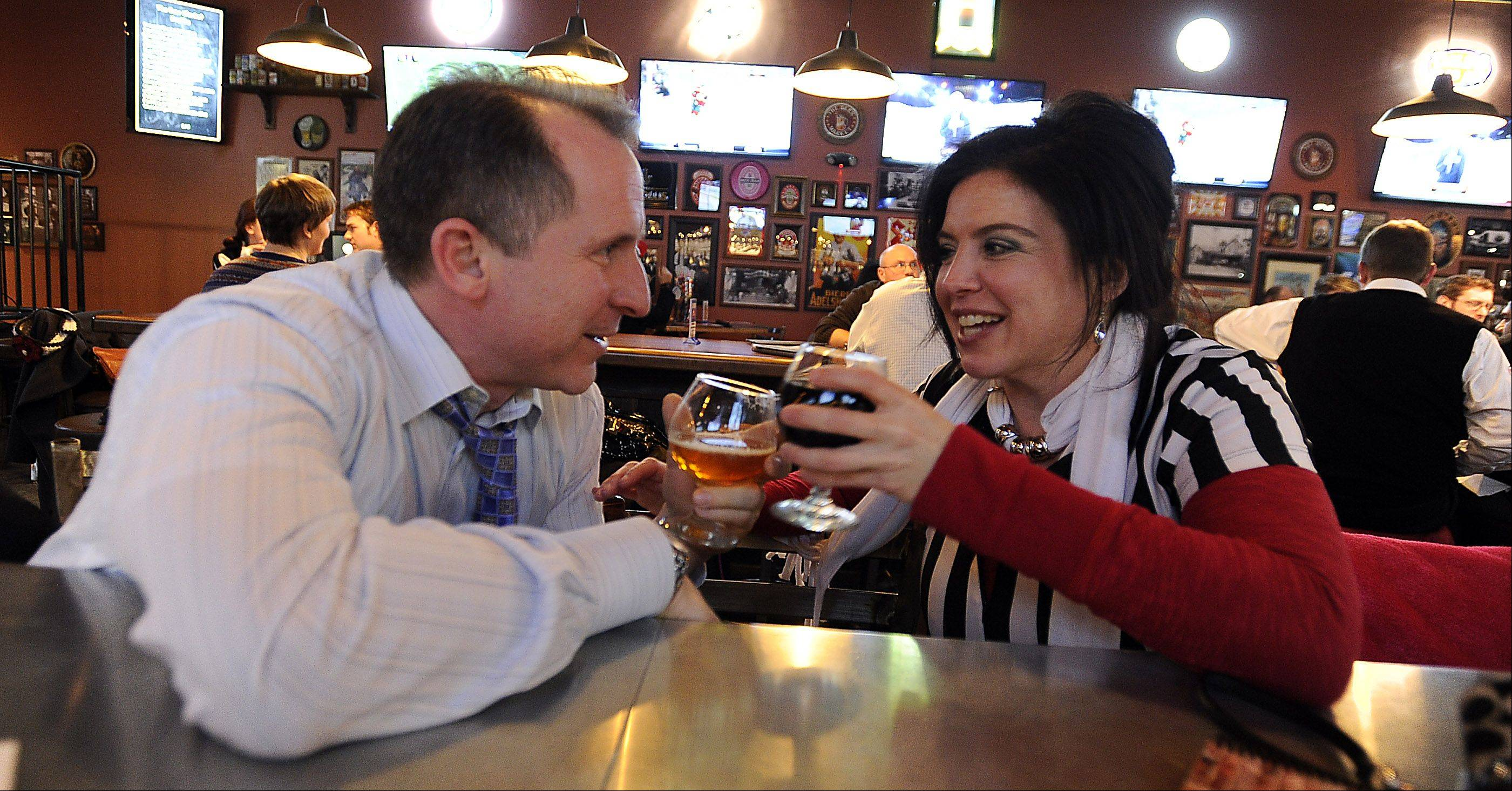 Tony Calvaretta of Schaumburg and Laura Quintero of Carpentersville sample some of the many offerings at The Beer Market in Schaumburg.