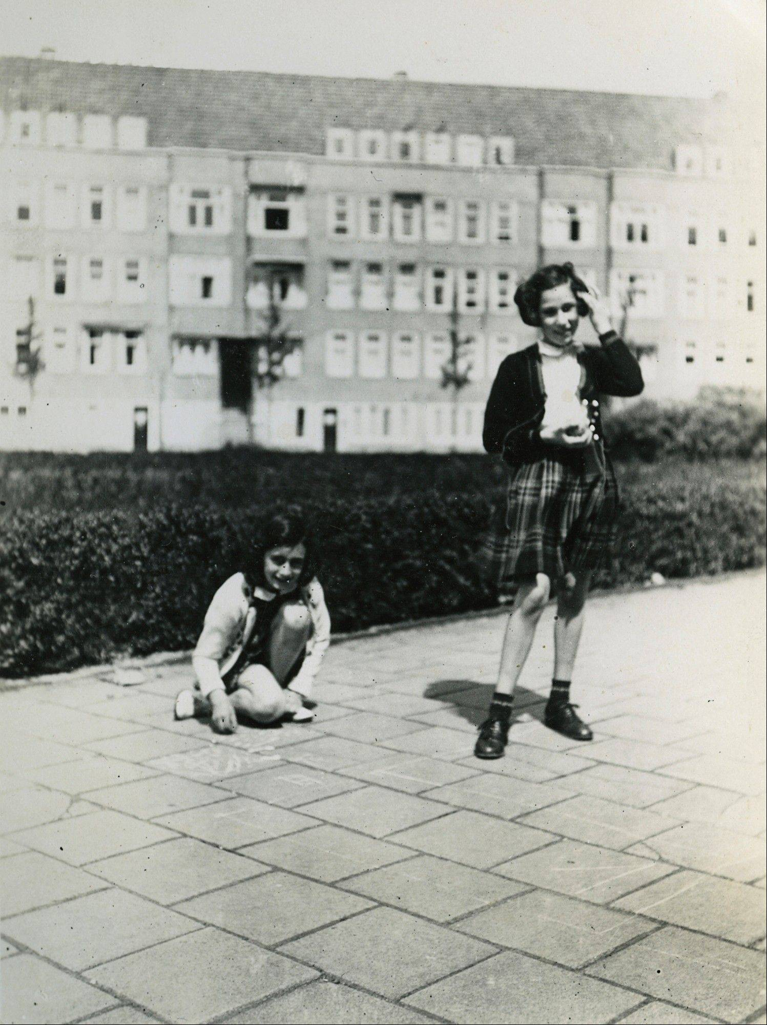Anne Frank, left, plays with her friend Hanneli Goslar, right, on the Merwedeplein square in Amsterdam. Shortly before Anne Frank and her family went into hiding from the Nazis, she gave away some of her toys to non-Jewish neighborhood girlfriend Toosje Kupers for safekeeping.