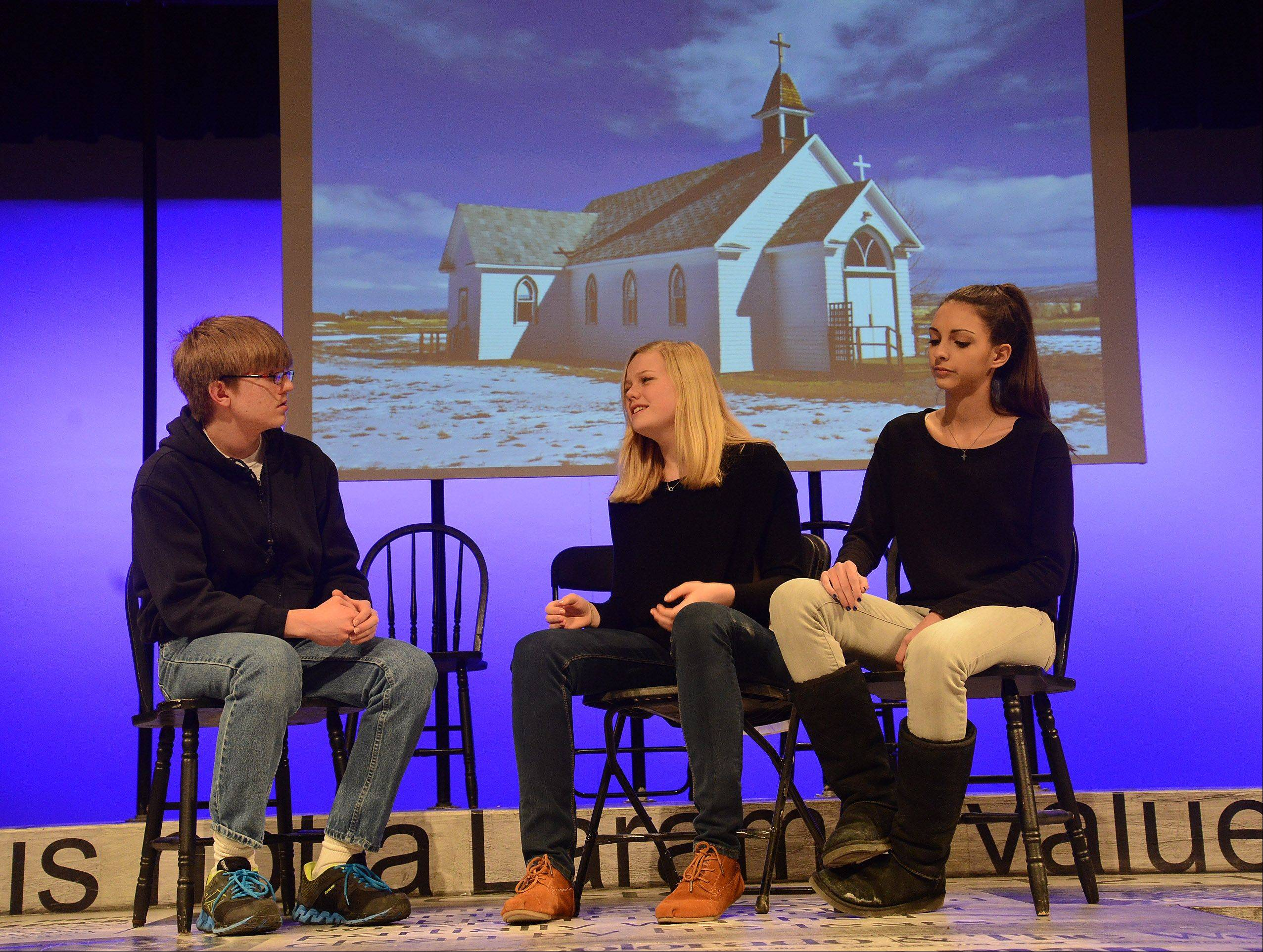 "Rolling Meadows High School students from left, Daniel Crusius, Lydia Schultz and Lexi Meschino rehearse for their upcoming performance in ""The Laramie Project."" The play recounts the 1998 murder of Matthew Shepard, a gay college from Wyoming."