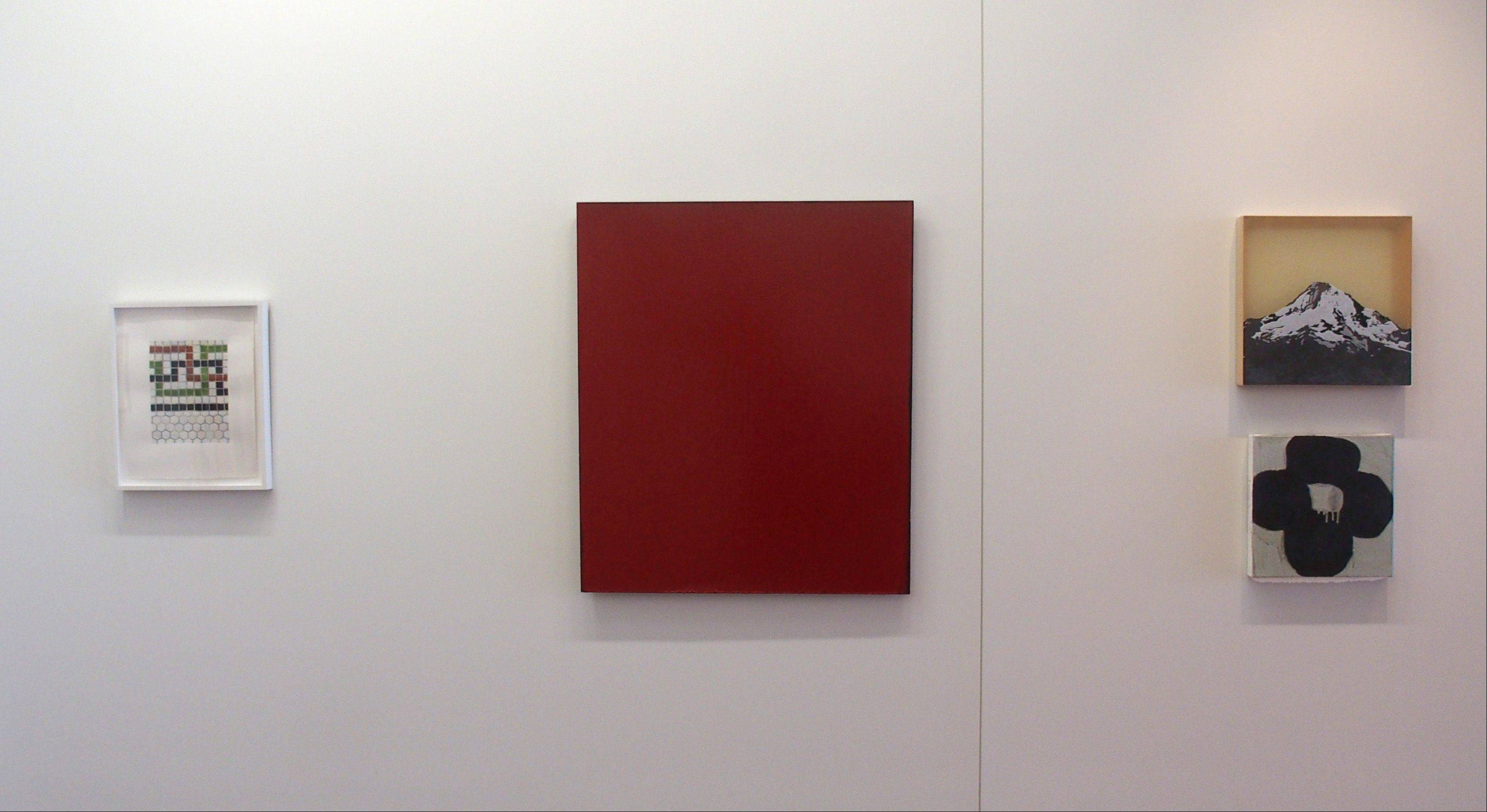 Red Painting #32, center, an acrylic on linen by Joseph Marioni, is one of the many works on display at the new Cleve Carney Art Gallery.