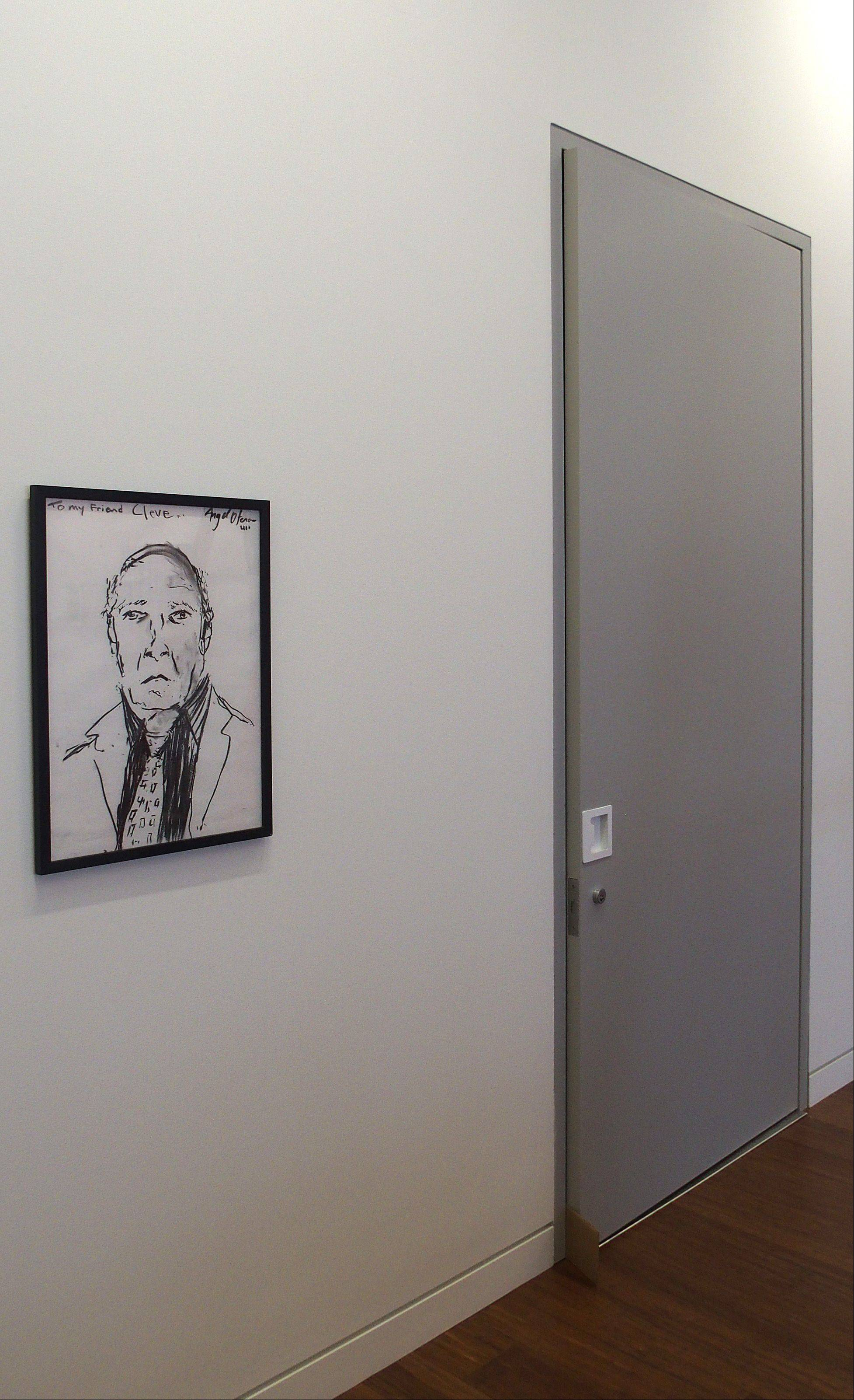 A charcoal drawing of Cleve Carney by Angel Otero is part of the exhibit on display at the new art gallery that bears Carney's name.