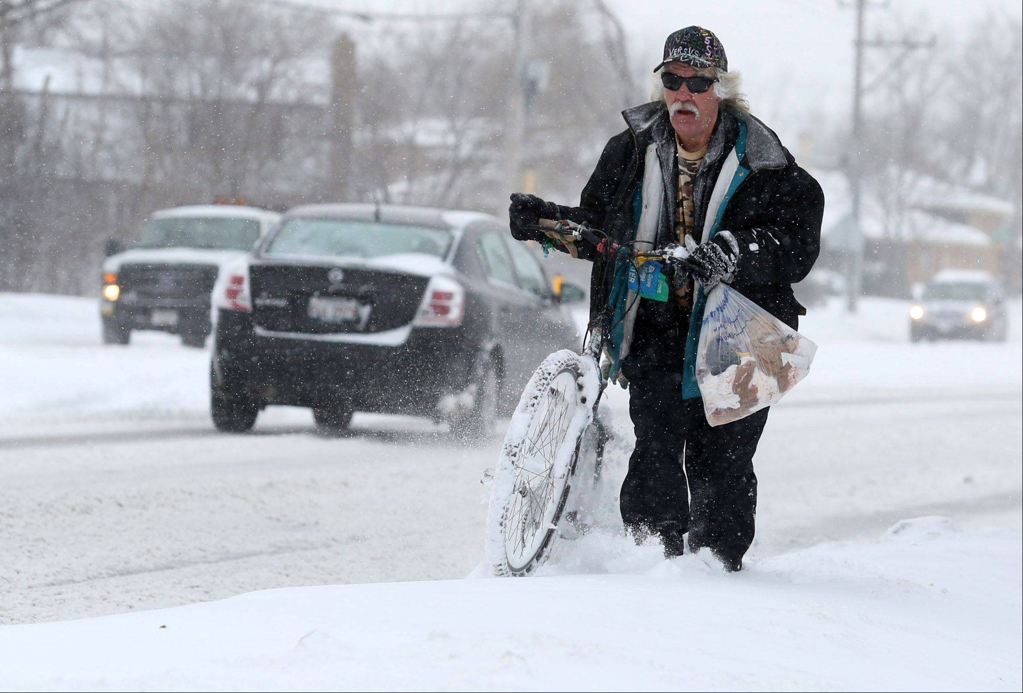 Rich Carlson of Des Plaines said he was riding, and mostly pushing, his bike on a 6-mile trip for exercise on Golf Road on Thursday in Des Plaines.