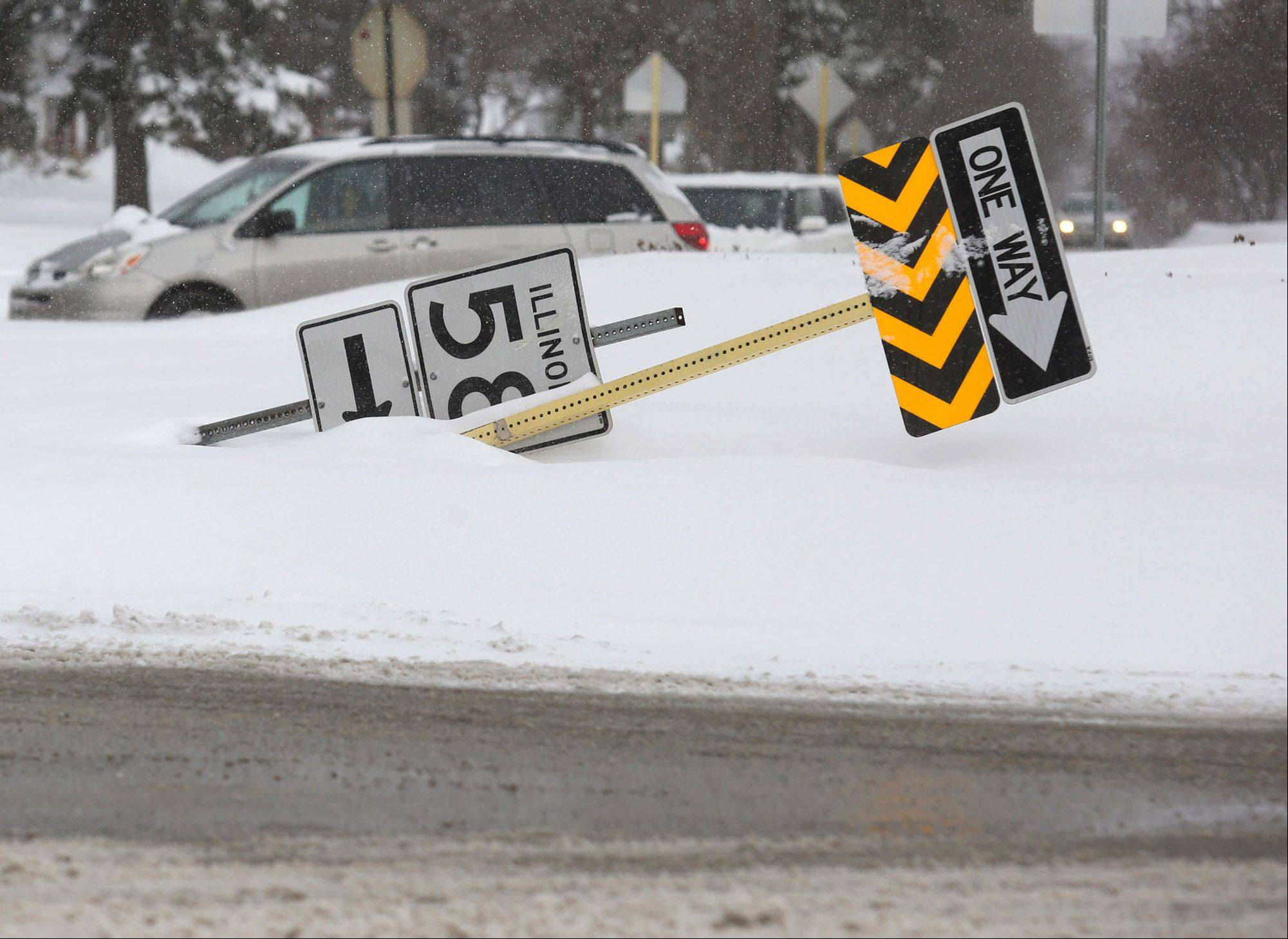 A sign on the Golf Road circle fell or was knocked down in Des Plaines on Thursday.