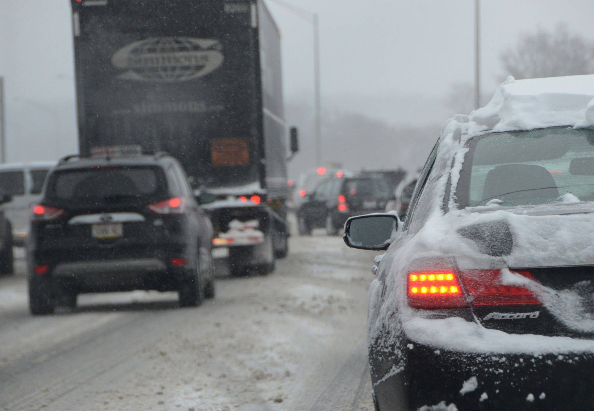Snow falling faster than the plows could move it caused major traffic delays on the eastbound Jane Addams expressway Wednesday morning.