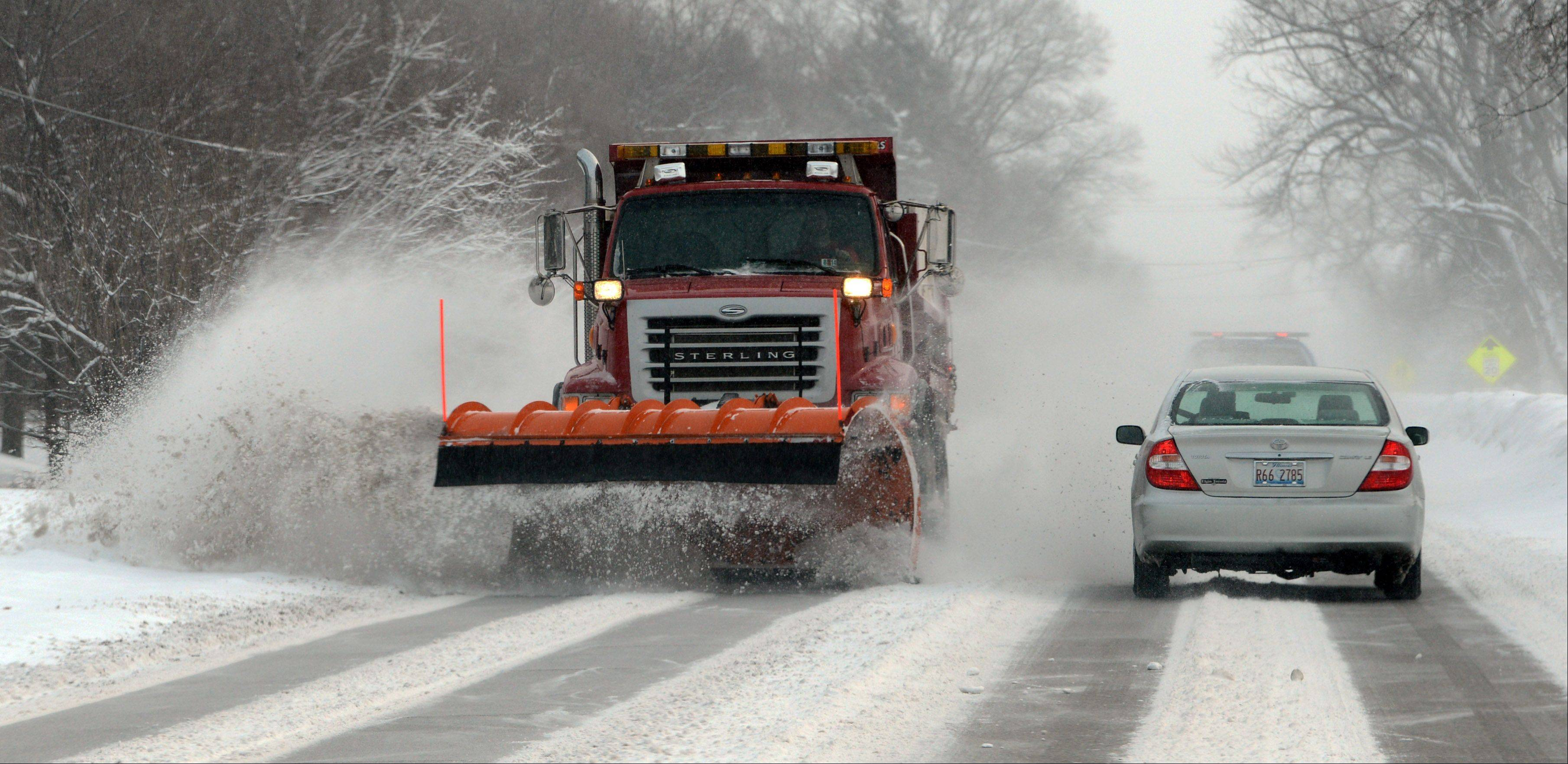 Snow plows were out in force Wednesday morning along Route 176 in Prairie Grove.