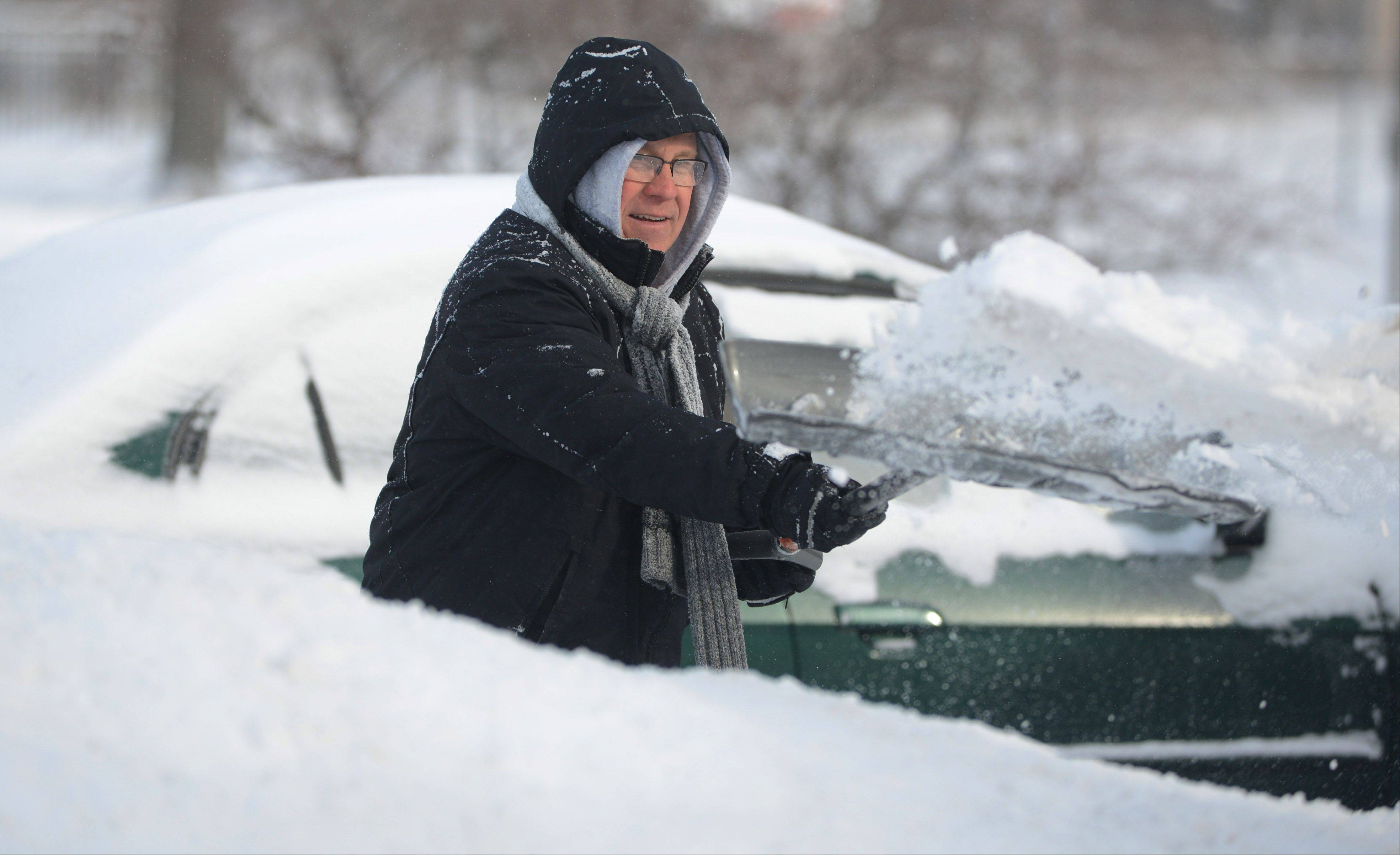 Wauconda resident Steve Ford shovels his driveway along Osage Street Wednesday morning.