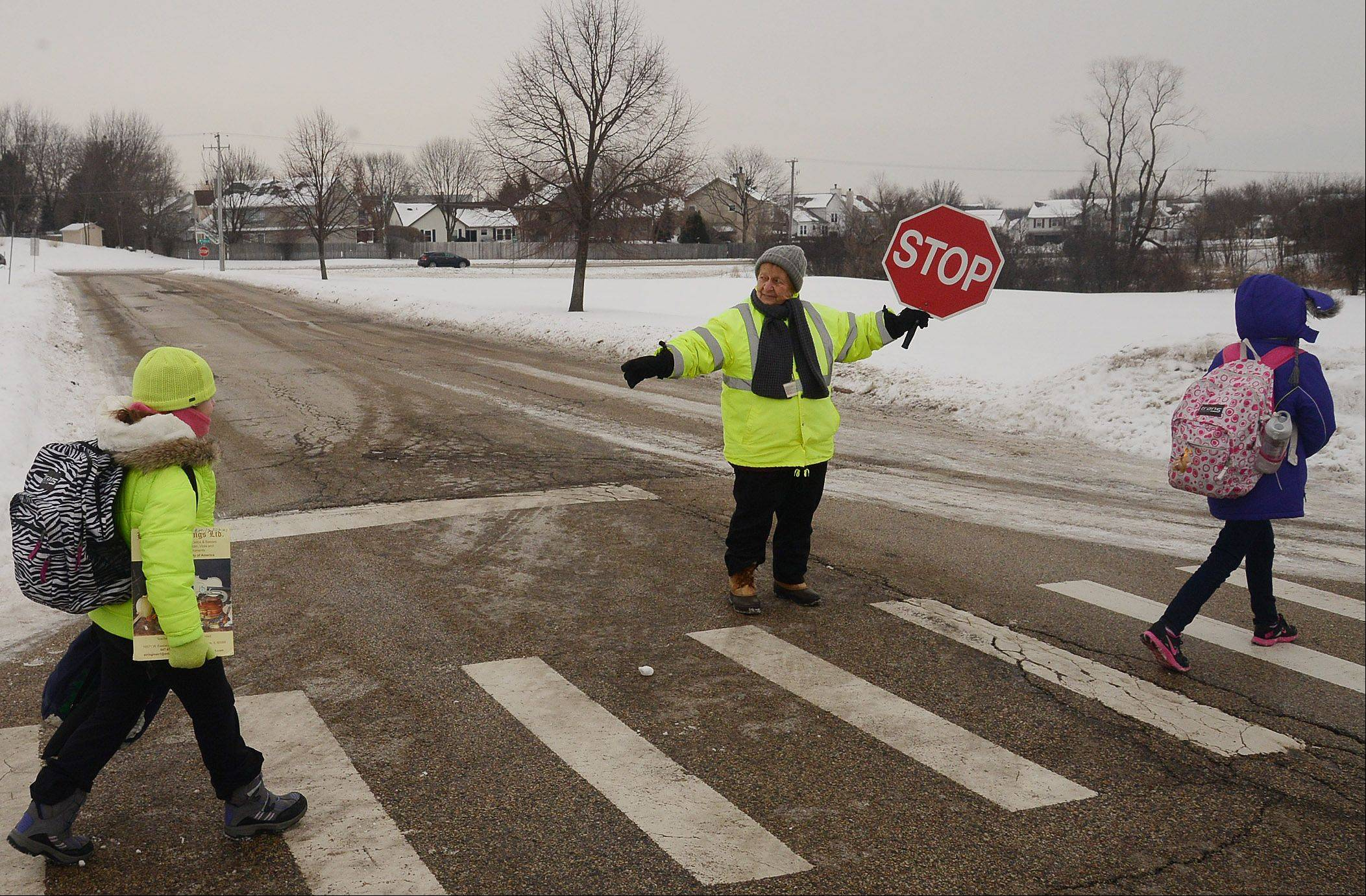 Bob Chwedyk/bchwedyk@dailyherald.comAt her post at Isaac Fox Elementary School, Marie McBride was honored for 40 years as a Lake Zurich crossing guard.