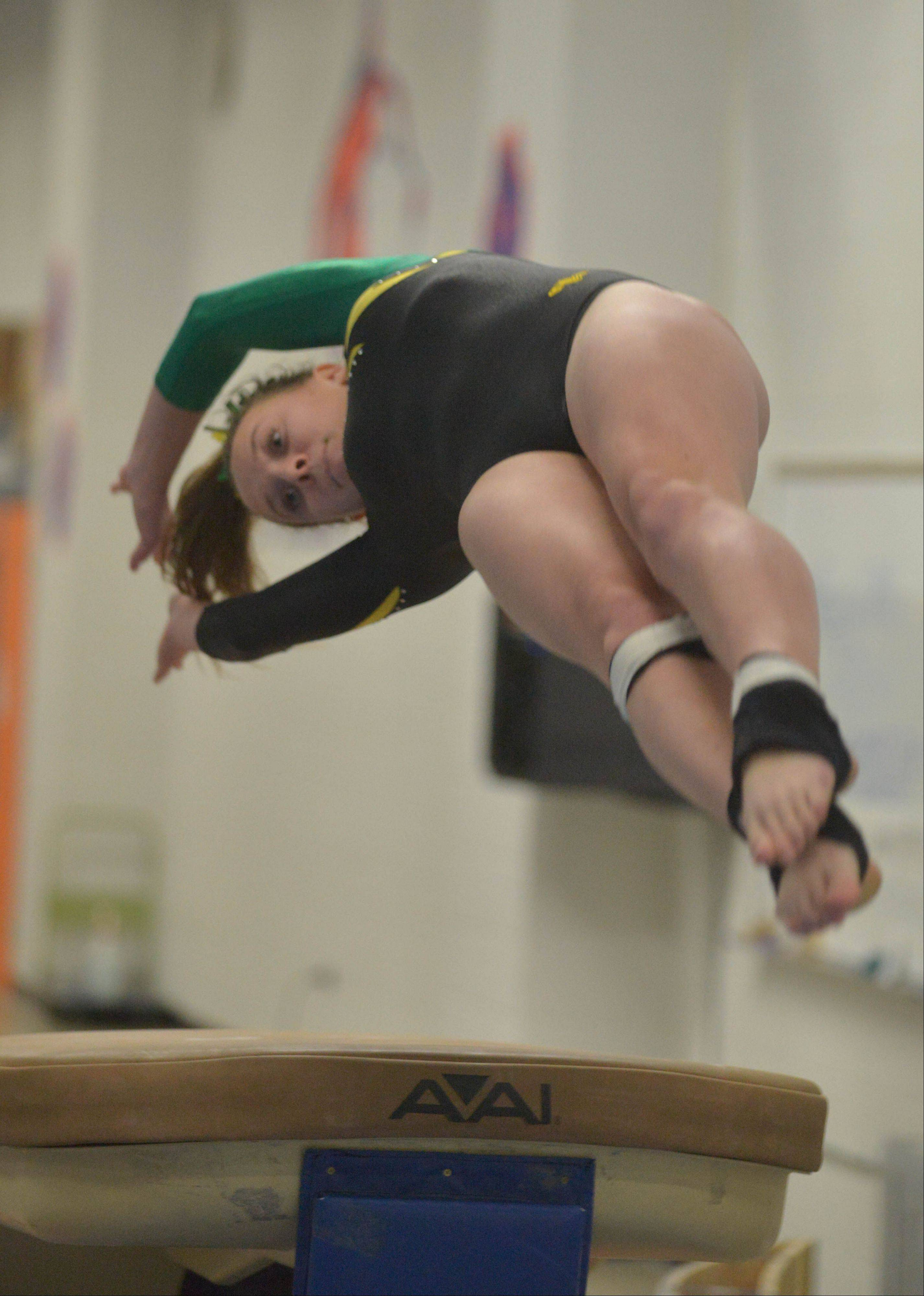 Veronica Zahn of Waubonsie Valley in Aurora on the vault during the Naperville North girls gymnastics regional Thursday at Naperville North High School in Naperville,