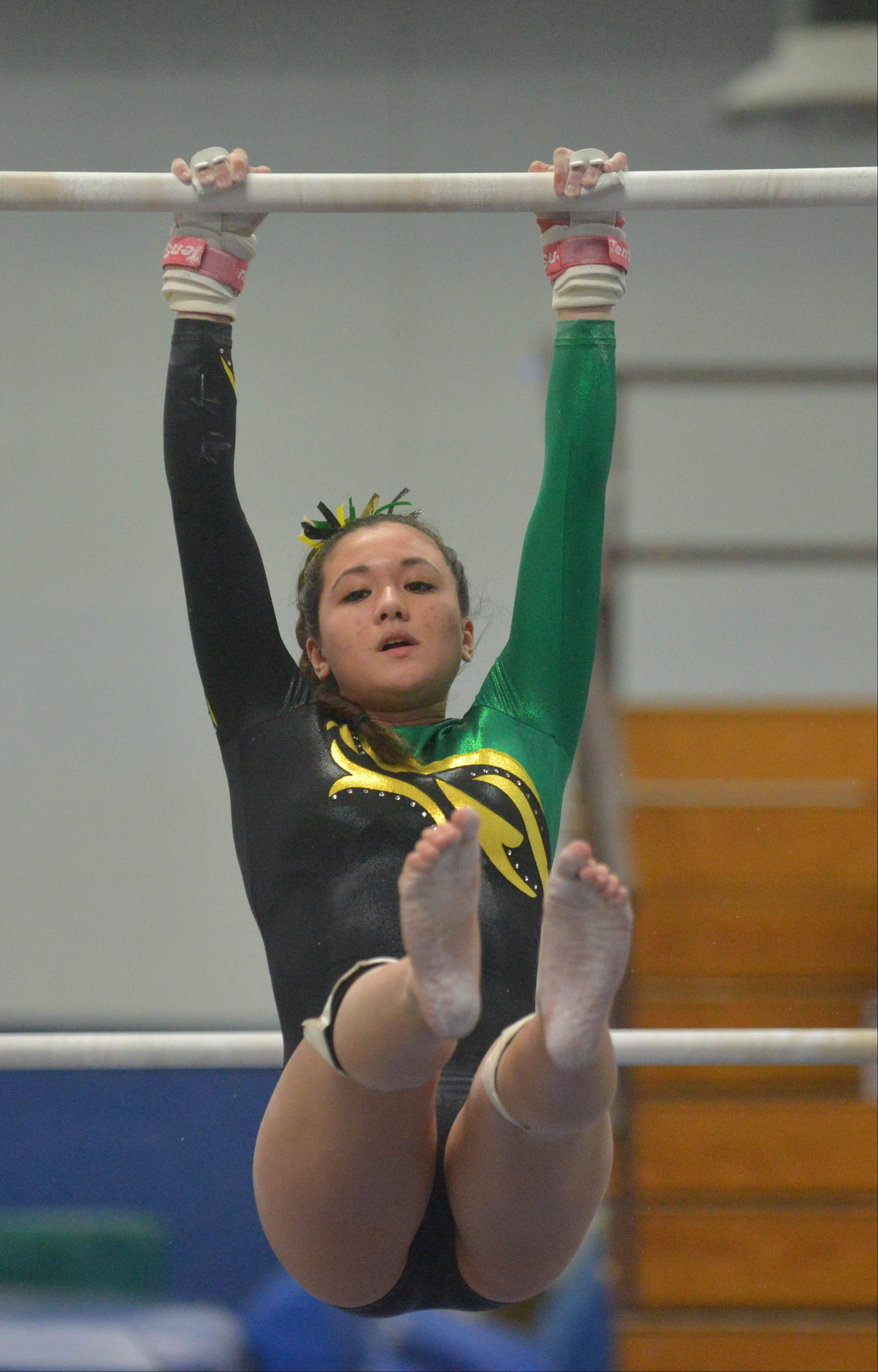Lauren Madamba of Waubonsie Valley on the Uneven parallel bars during the Naperville North girls gymnastics regional Thursday at Naperville North High School in Naperville.
