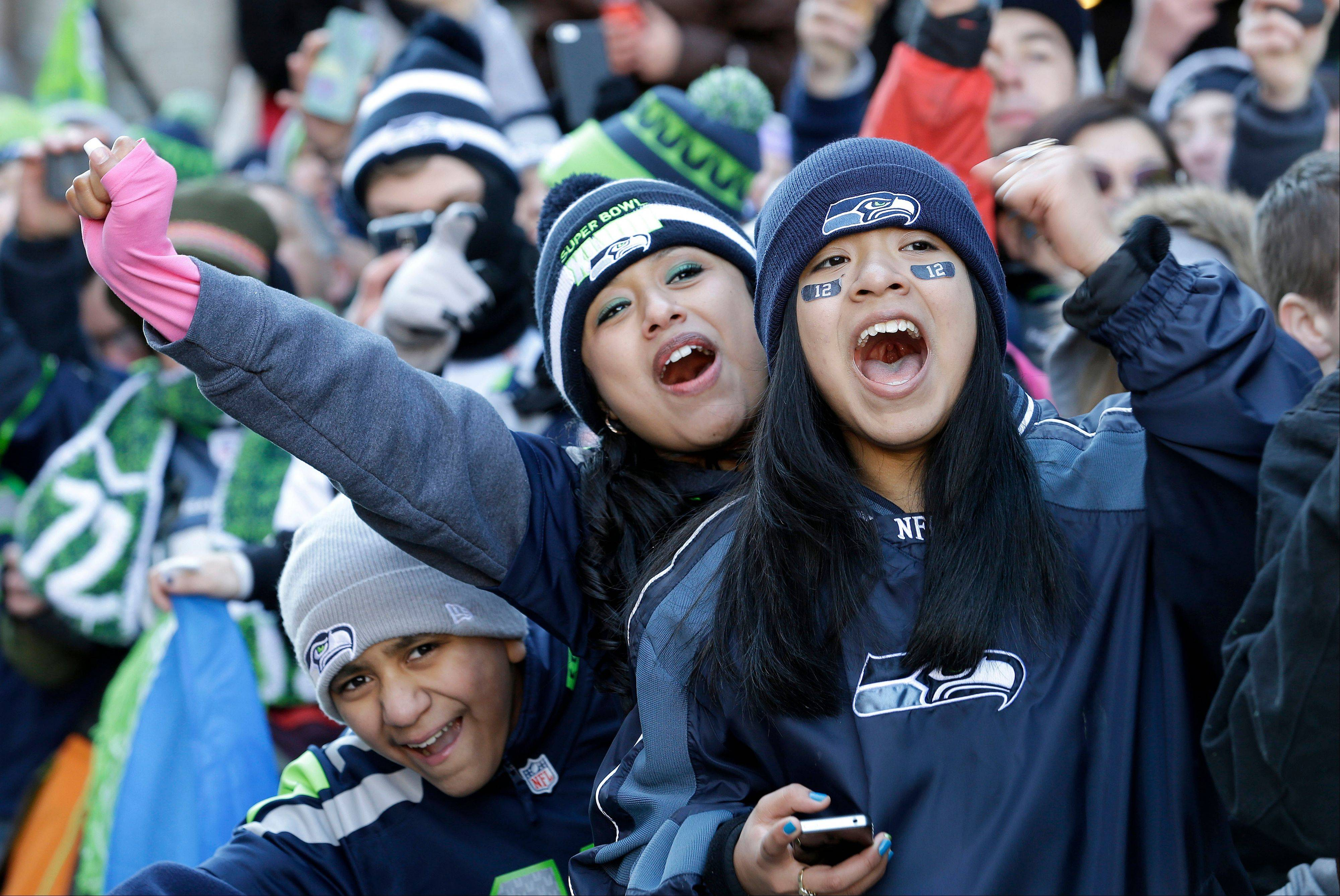 Seattle Seahawks fans cheer during the a parade for the NFL football Super Bowl champions, Wednesday, Feb. 5, 2014, in Seattle. The Seahawks defeated the Denver Broncos 43-8 on Sunday.