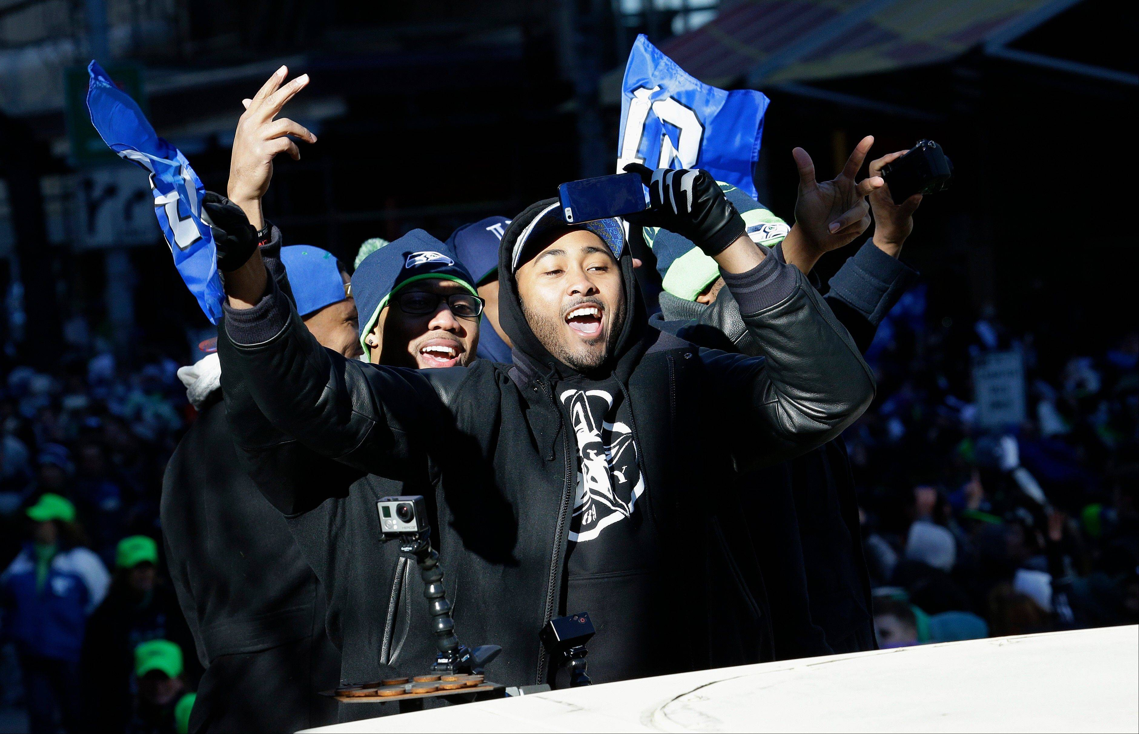 Seattle Seahawks linebacker and Super Bowl MVP Malcolm Smith gestures to fans during the Super Bowl champions parade, Wednesday, Feb. 5, 2014, in Seattle. The Seahawks defeated the Denver Broncos 43-8 in NFL football's Super Bowl XLVIII on Sunday.