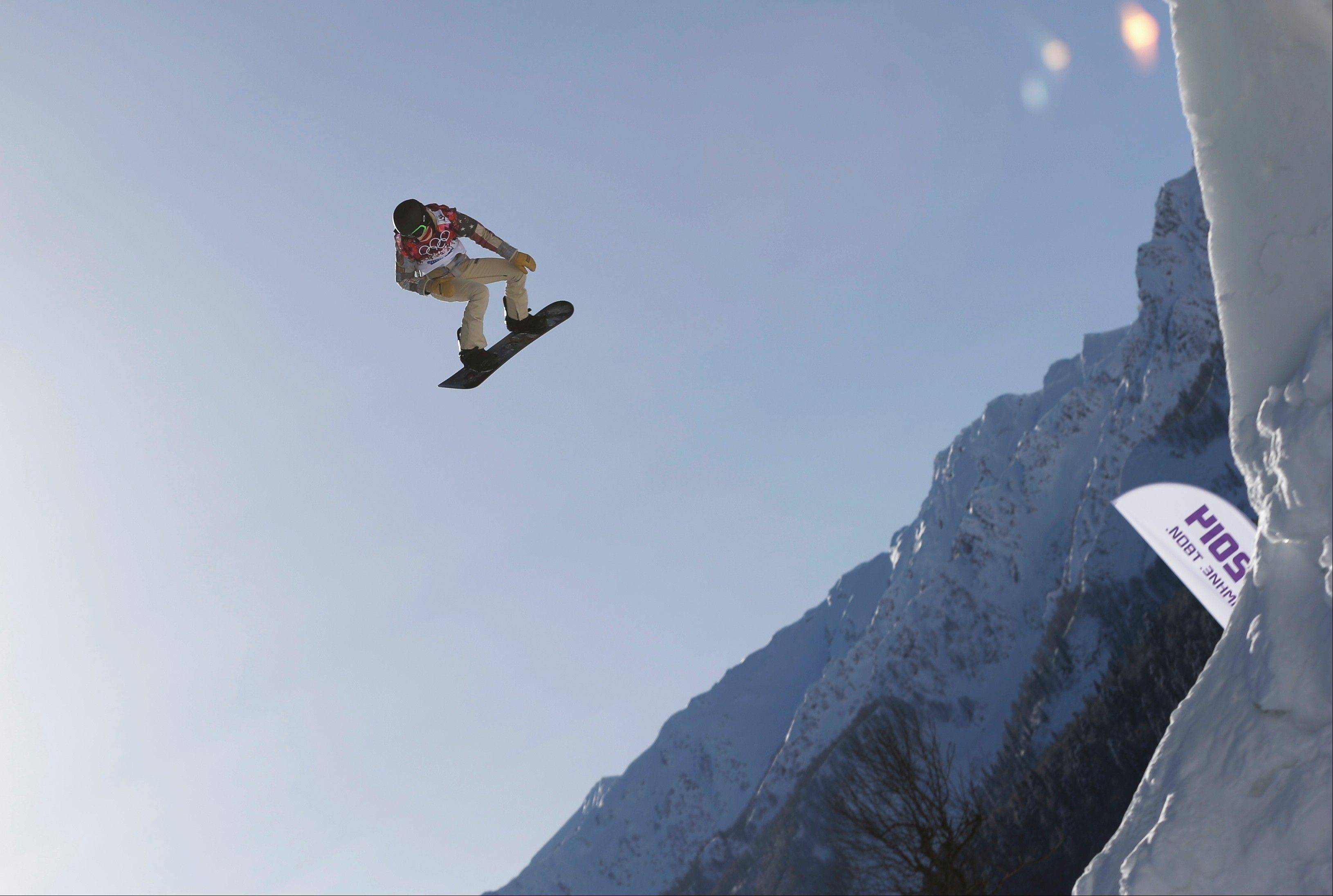 Shaun White of the United States takes a jump during a Snowboard Slopestyle training session at the Rosa Khutor Extreme Park in Krasnaya Polyana, Russia, prior to the 2014 Winter Olympics. White said Wednesday, Feb. 5, that he is pulling out of the Olympic slopestyle contest to focus solely on winning a third straight gold medal on the halfpipe.