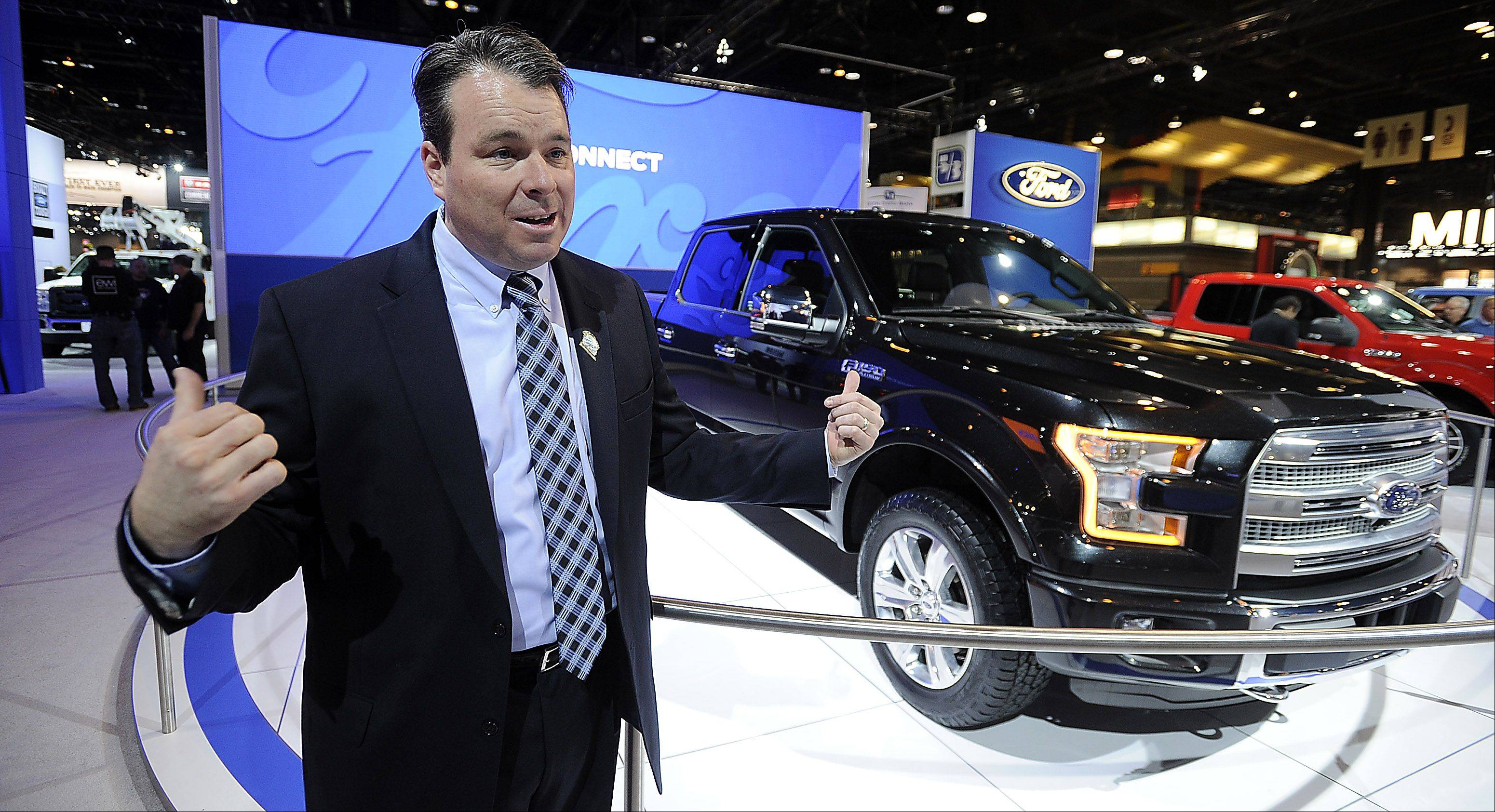 Colin Wickstrom of Wickstrom Ford Lincoln in Barrington shows off the revolutionary 2015 Ford F-150, made with an aluminum frame, at the Chicago Auto Show Thursday.