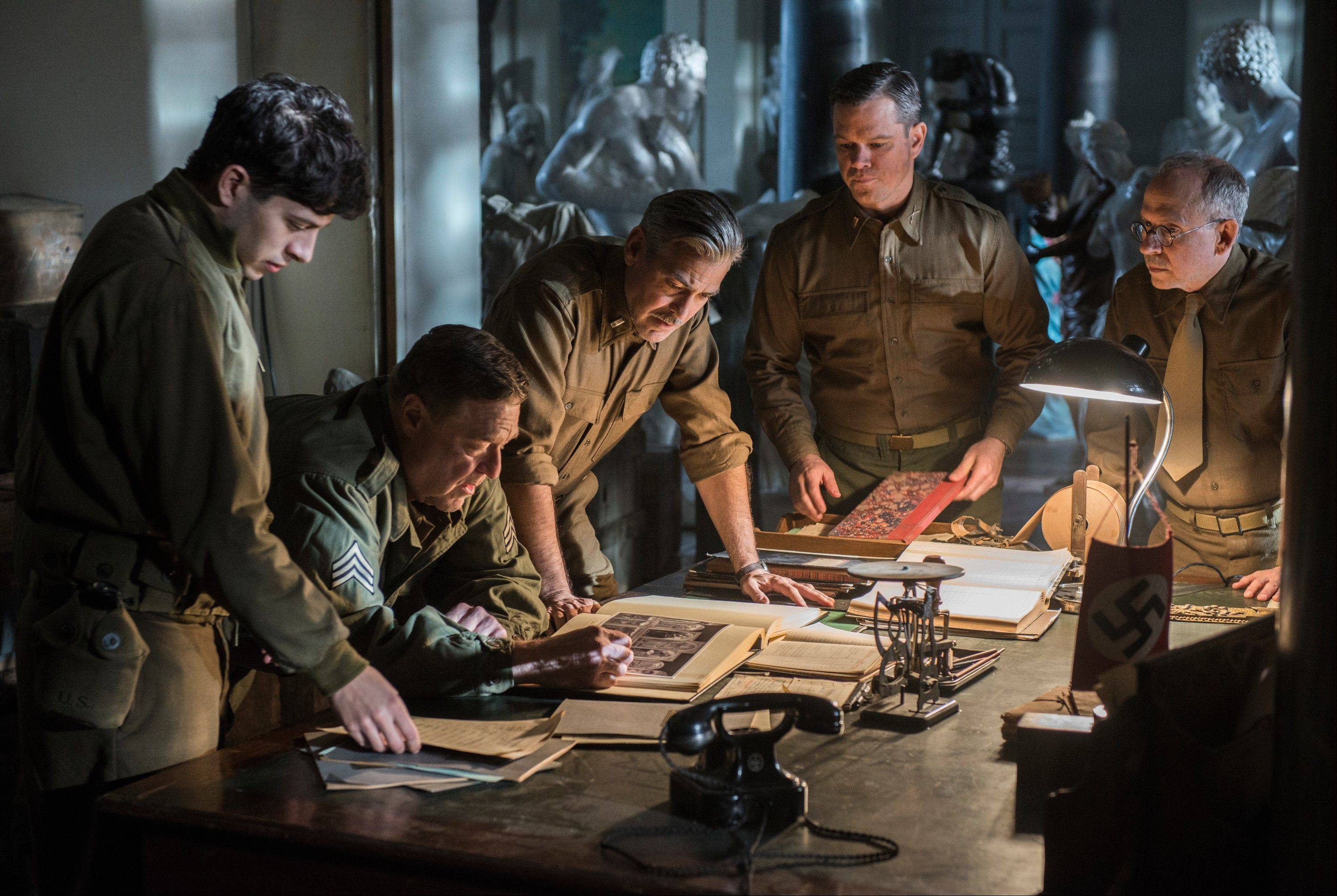 "Dimitri Leonidas, left, John Goodman, George Clooney, Matt Damon and Bob Balaban look for stolen art in George Clooney's fact-based drama ""The Monuments Men."""