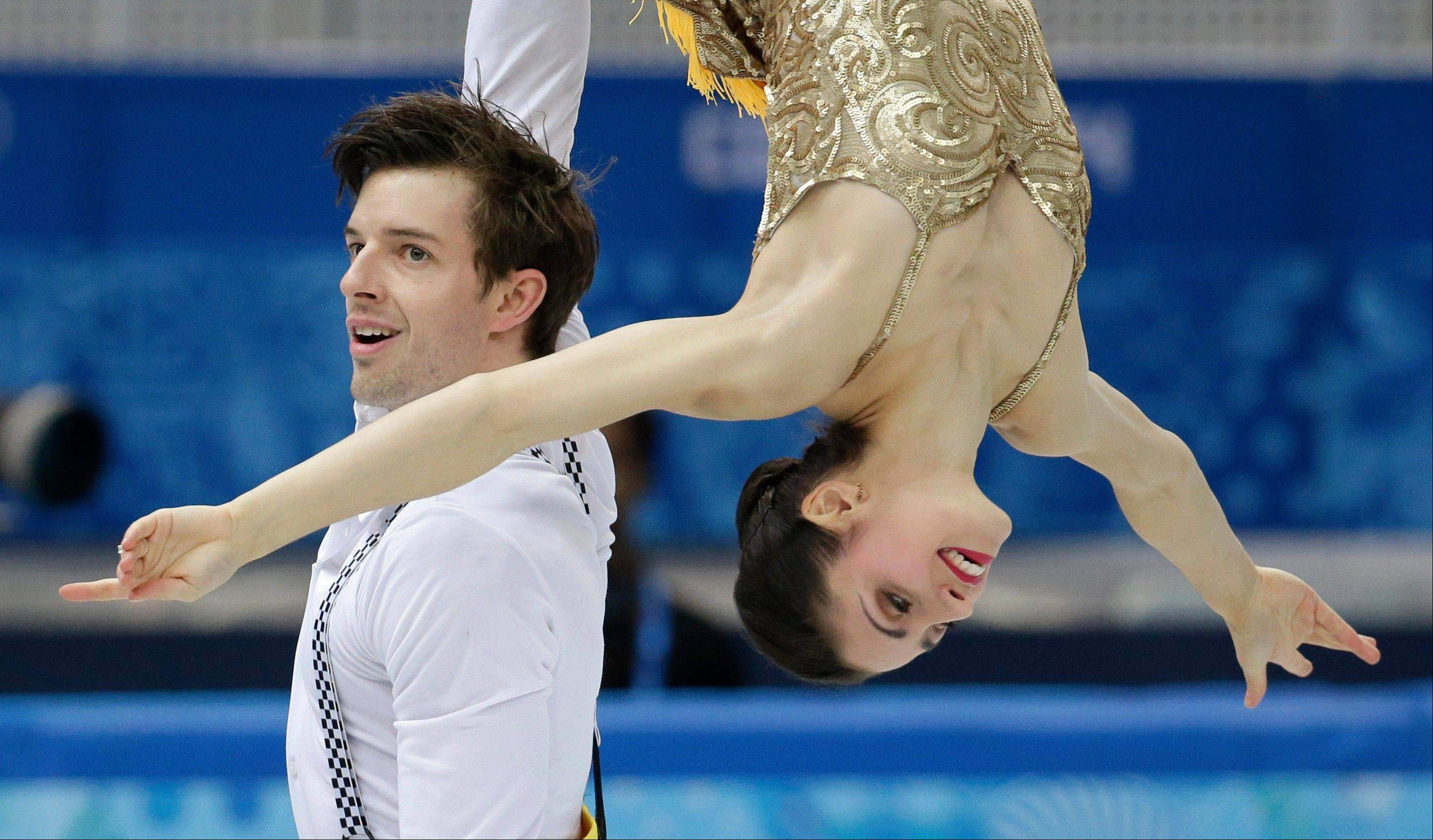 Stefania Berton and Ondrej Hotarek of Italy compete in the team pairs short program figure skating competition at the Iceberg Skating Palace during the 2014 Winter Olympics.