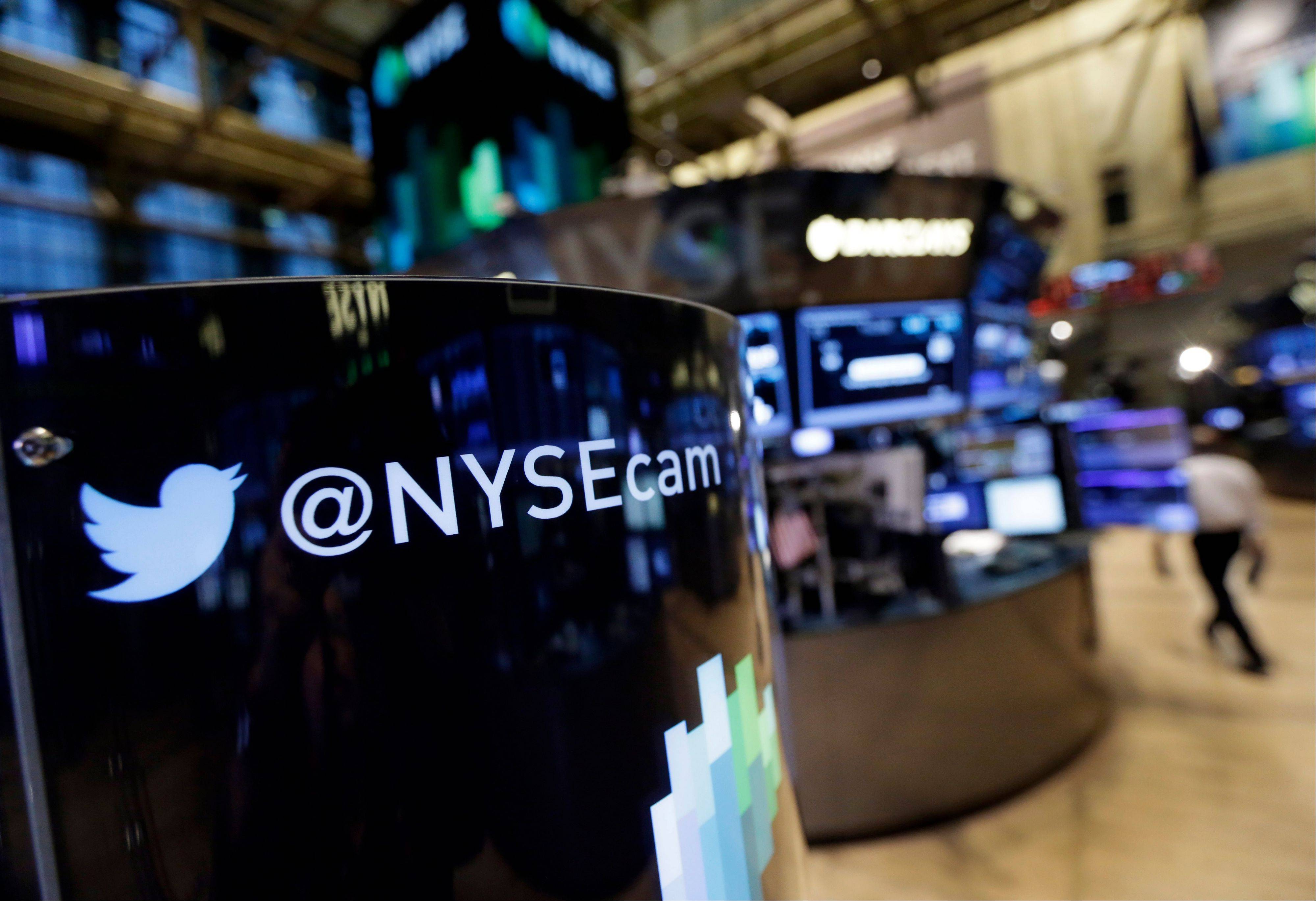 Associated PressA phone post on the floor of the New York Stock Exchange features a Twitter logo. Twitter Inc., the microblogging service that amassed more than 200 million users in seven years, is now struggling to widen its audience as quickly. The shares tumbled in U.S. trading.