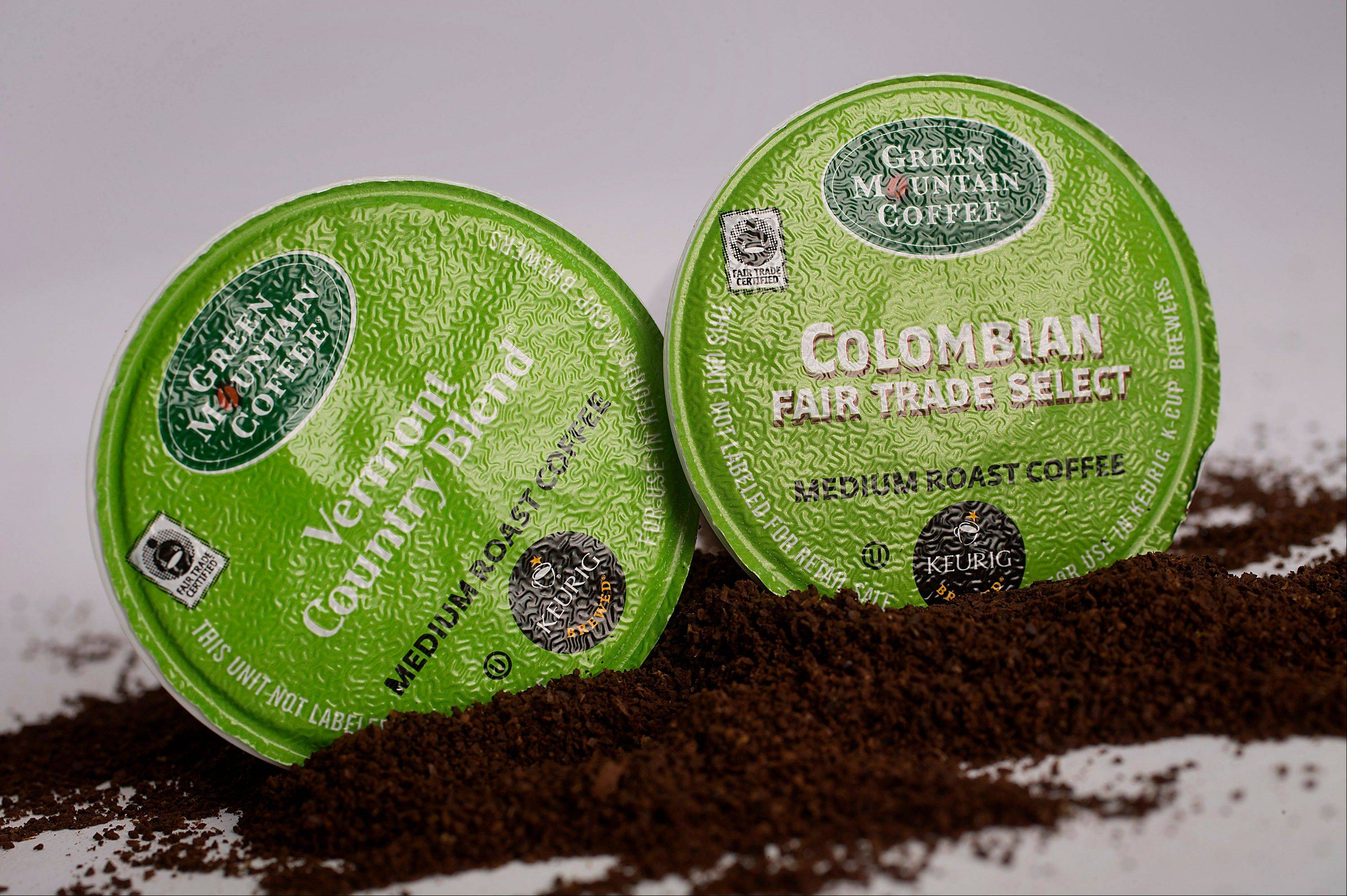 Coca-Cola said Wednesday that it's buying a 10 percent stake in Green Mountain Coffee Roasters Inc. for $1.25 billion as part of an agreement to bring its familiar brands into the fast-growing at-home market.