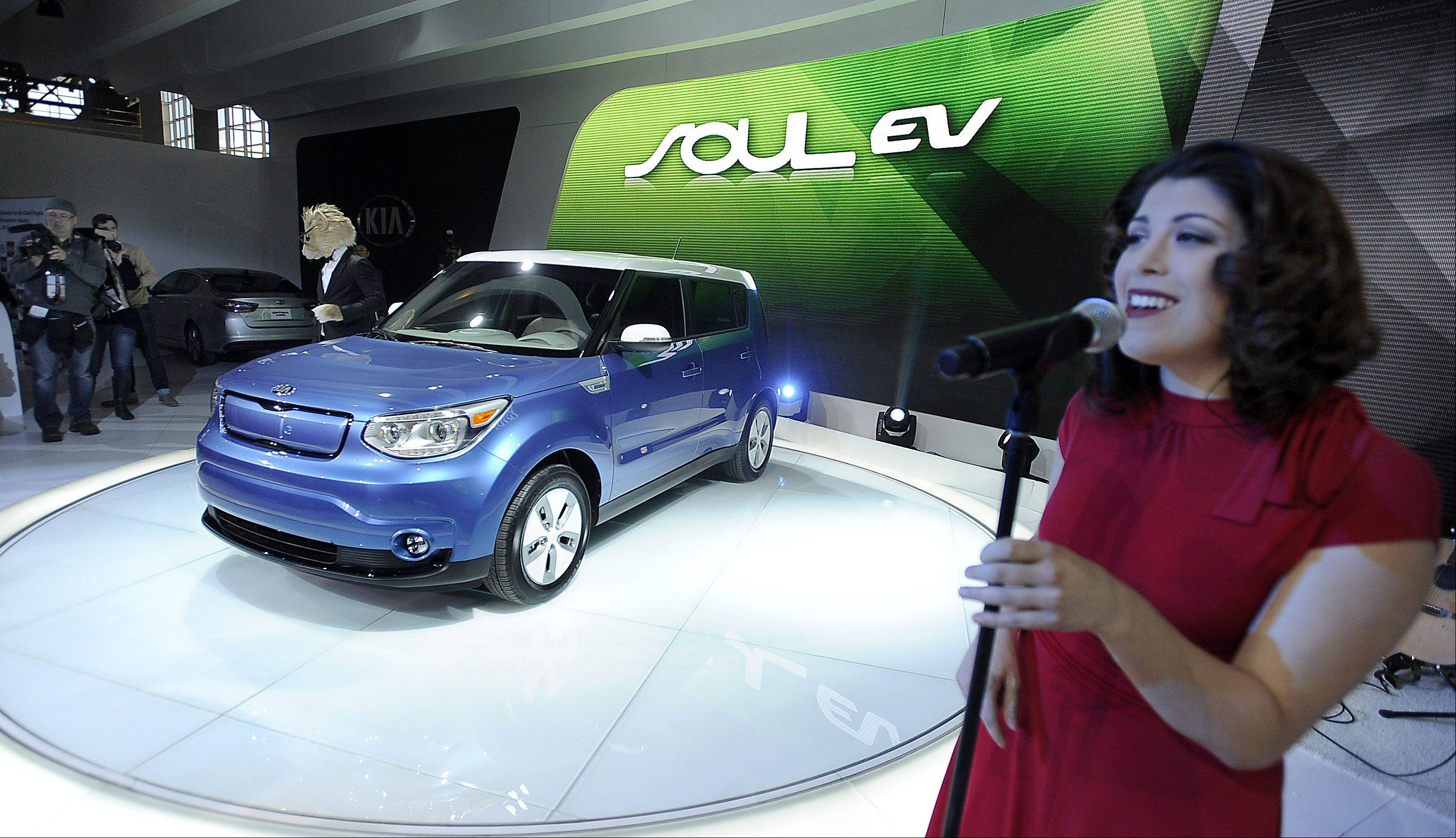 Mark Welsh/mwelsh@dailyherald.comSinger Kristina Cottone introduces Kia's 2015 Soul EV, an electric version of the popular car, at the 2014 Chicago Auto Show on Thursday.
