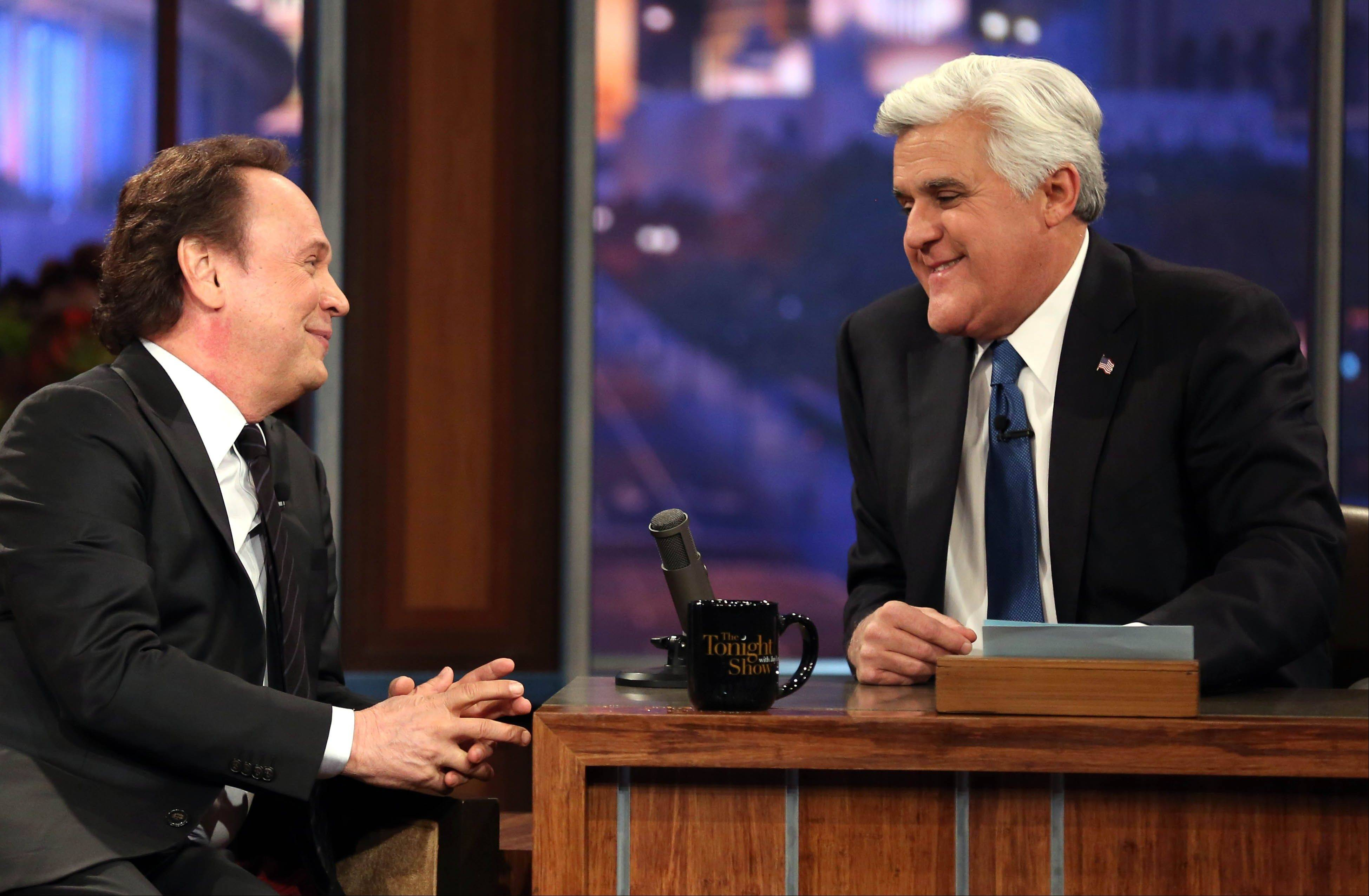 "Billy Crystal, left, talks to host Jay Leno during the final taping of NBC's ""The Tonight Show with Jay Leno,"" in Burbank, Calif., on Thursday. Leno brings his 22-year career as the show host to an end Thursday in a special one-hour farewell broadcast."