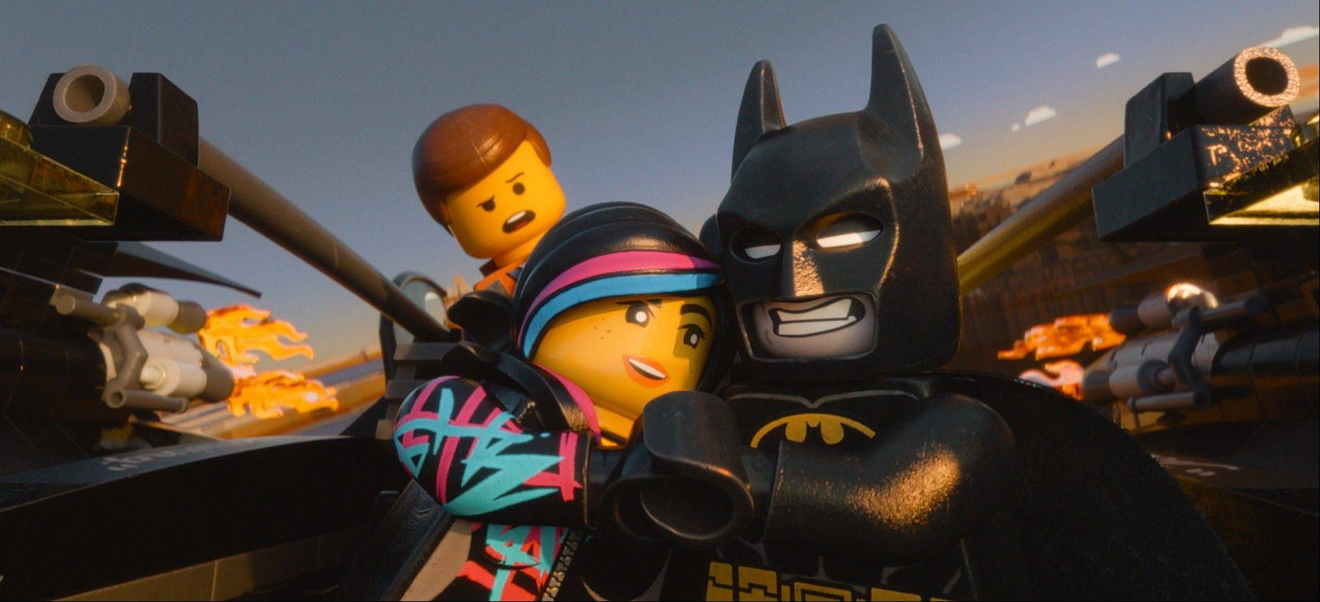 "Emmet (Chris Pratt), Wyldstyle (Elizabeth Banks) and Batman (Will Arnett) prepare to battle President Business in ""The Lego Movie."""