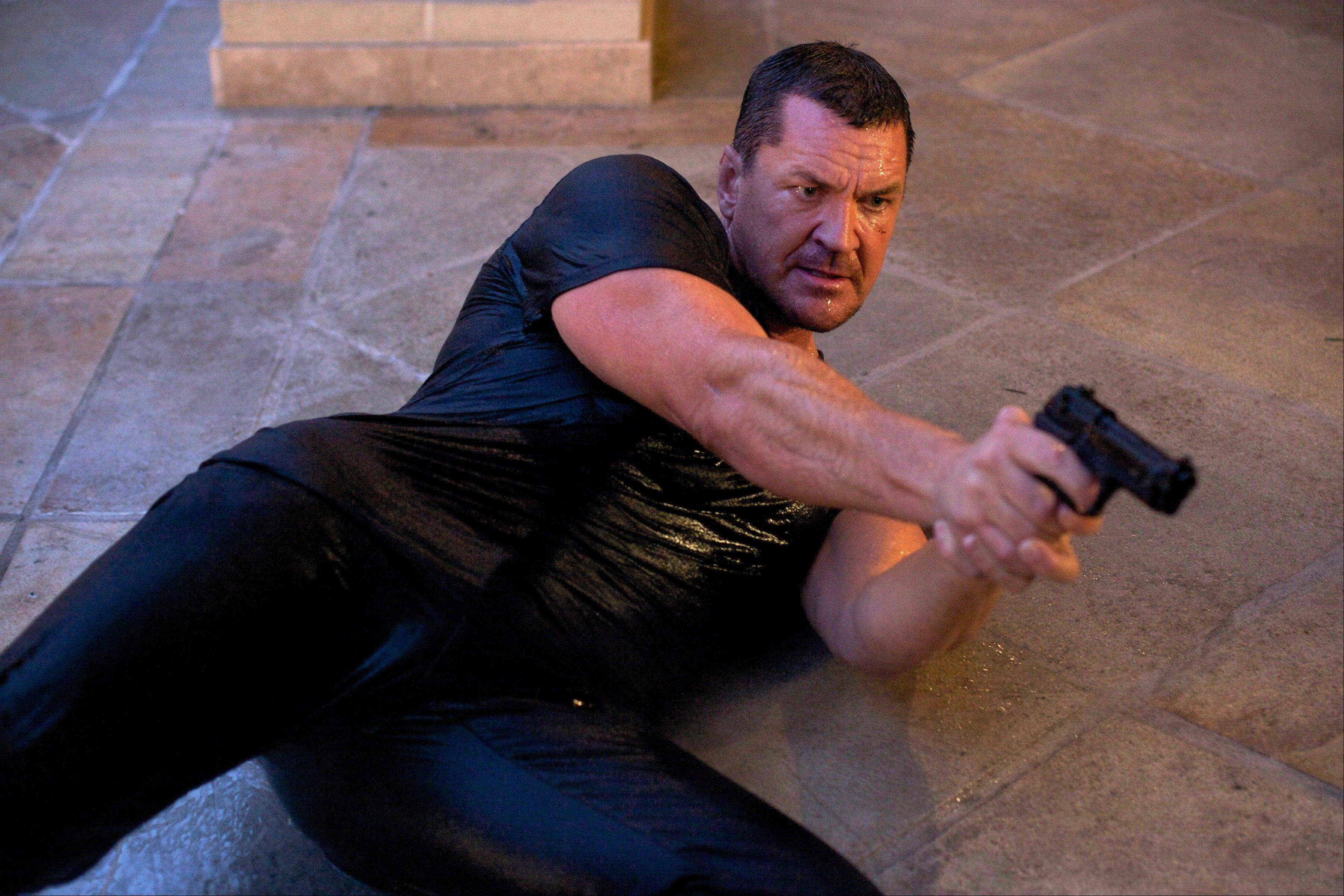 "British action star Craig Fairbrass demonstrates his fighting style in the thriller ""The Outsider."""