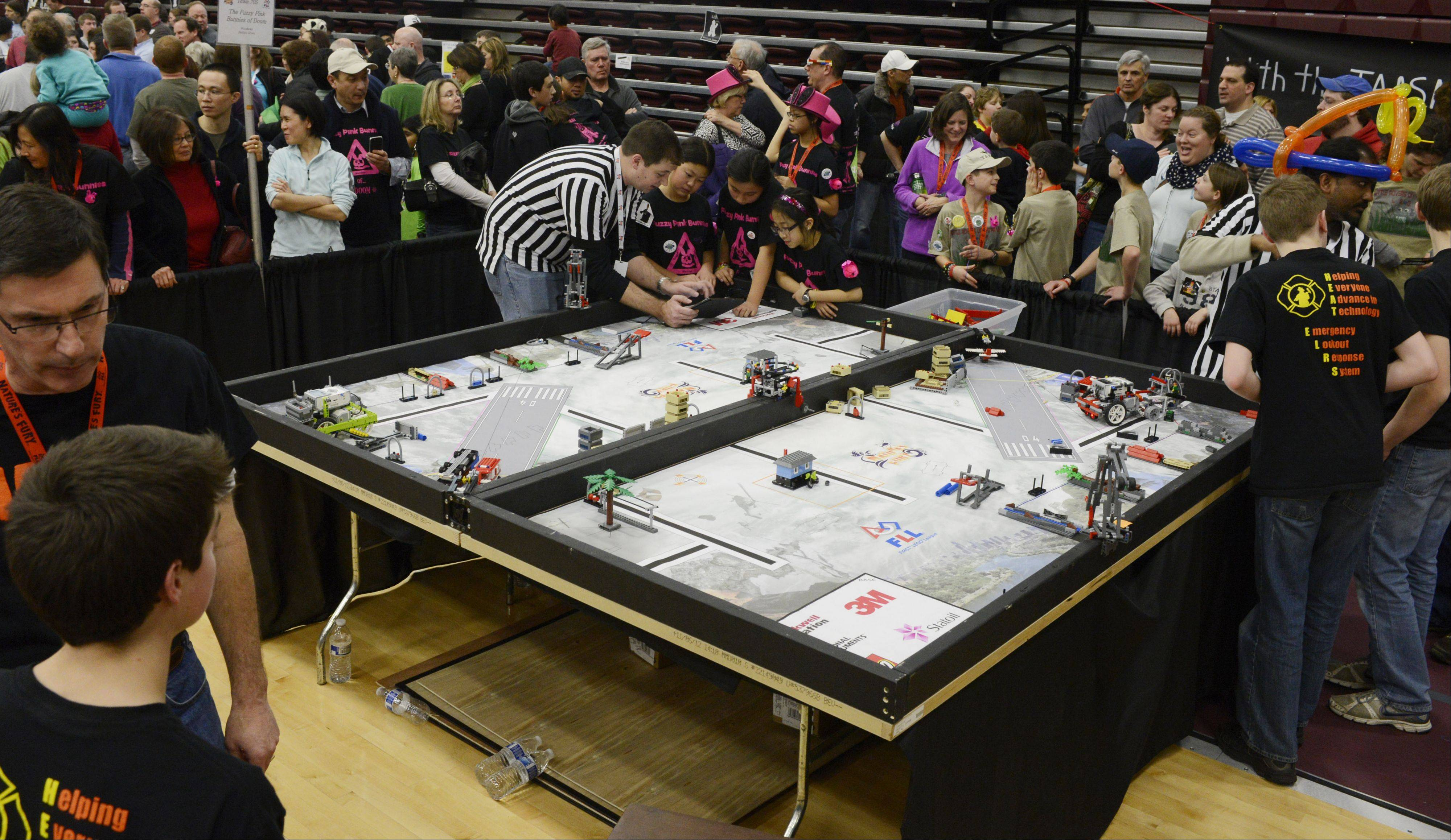 Teams participate in the Illinois First Lego League's Northern Illinois title competition Saturday at the Forest View Educational Center in Arlington Heights.