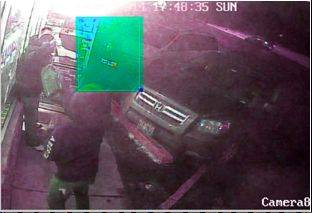 A surveillance photo shows one of two suspects involved in the armed robbery and fatal shooting of Hussein Saghir on Jan. 19 in front of Sam's Tobacco and Food Mart in Bensenville.