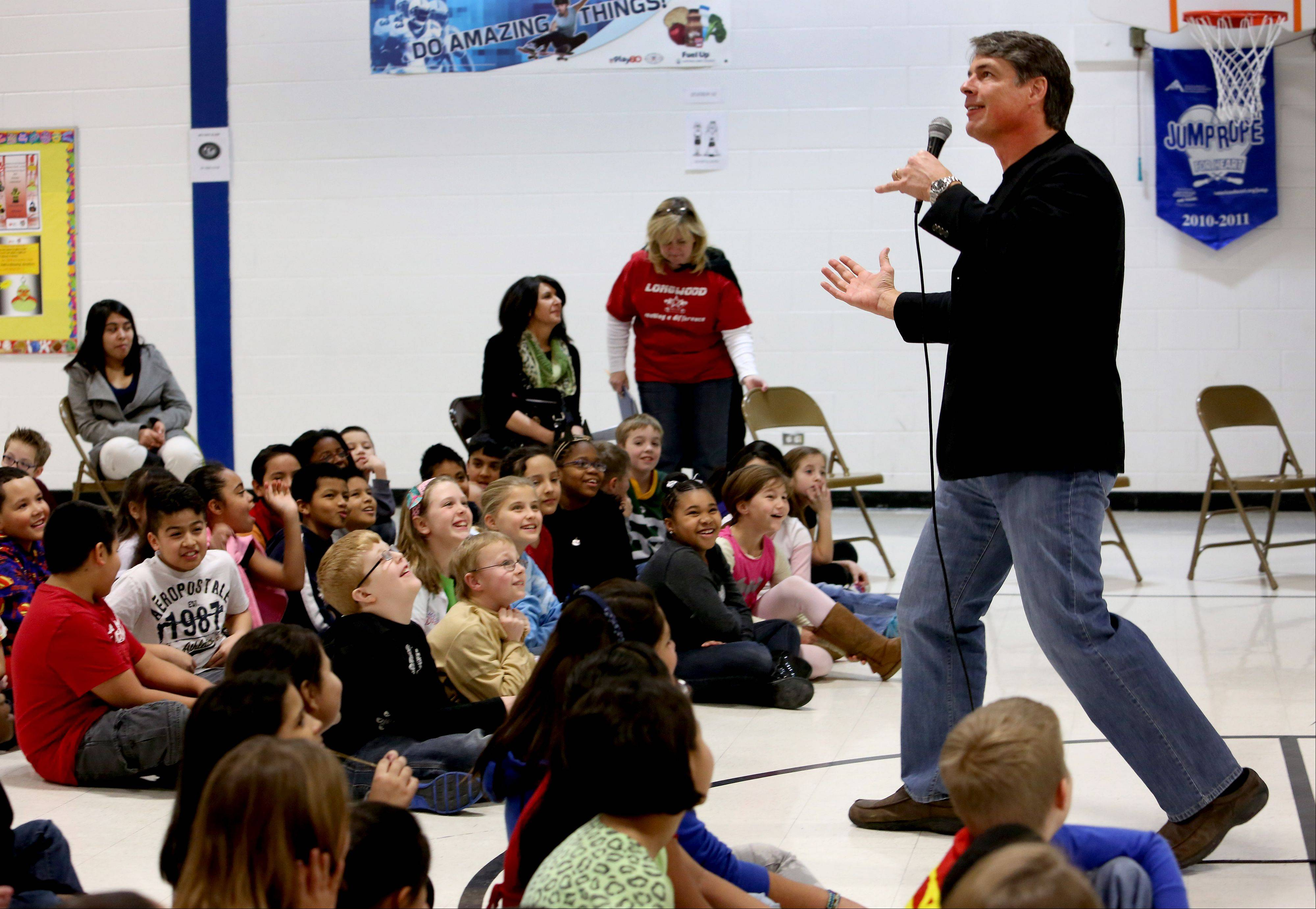 Former NFL football player and children's author Tim Green tells his story to fourth- and fifth-graders during a Naperville READS presentation Thursday at Longwood Elementary School.