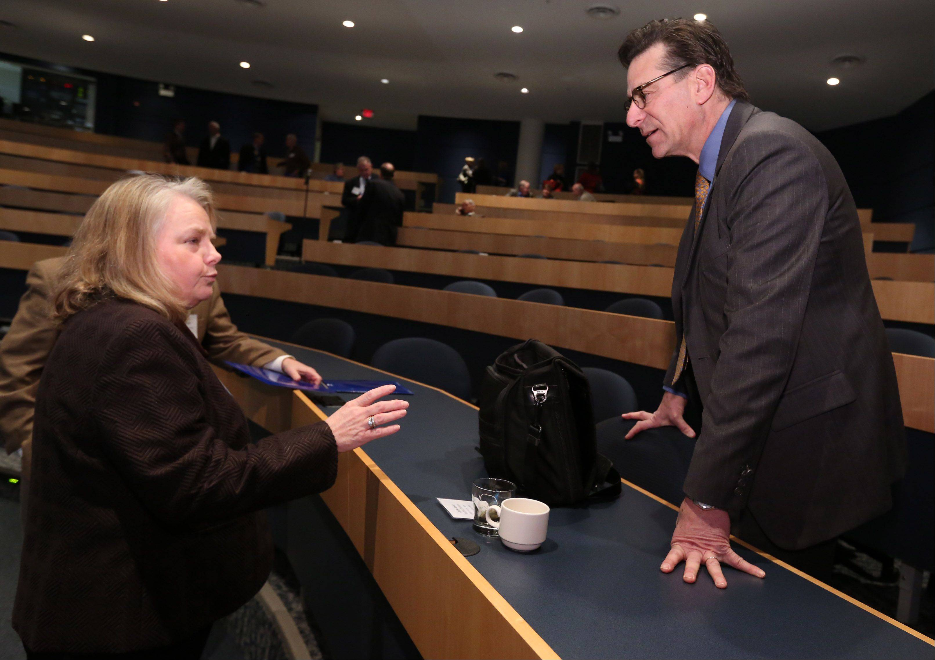 Jack Ablin, chief investment officer for BMO Private Bank, right, speaks with Mary Beth Pinda, managing consultant with MBP and Associates in South Barrington, before an economic outlook breakfast at Harper College on Thursday in Palatine.