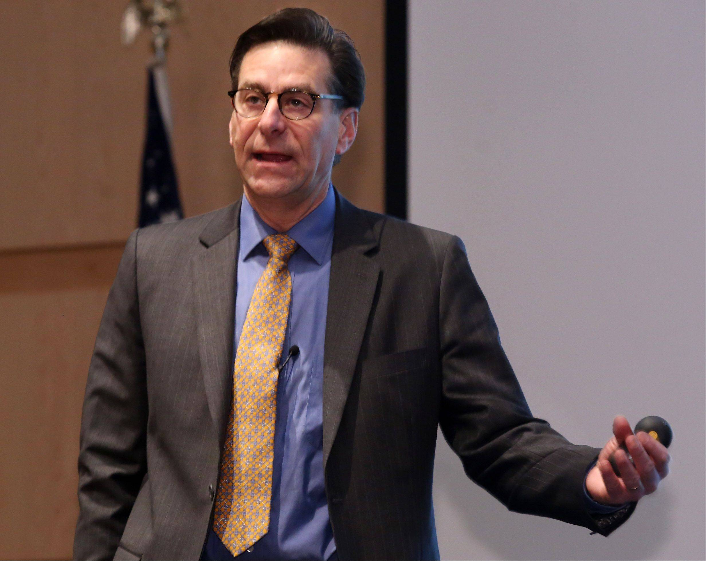 Jack Ablin, chief investment officer for BMO Private Bank, talks about how increasing minimum wage would help businesses make a higher profit at the economic outlook breakfast at the Wojcik Conference Center at Harper College on Thursday in Palatine.