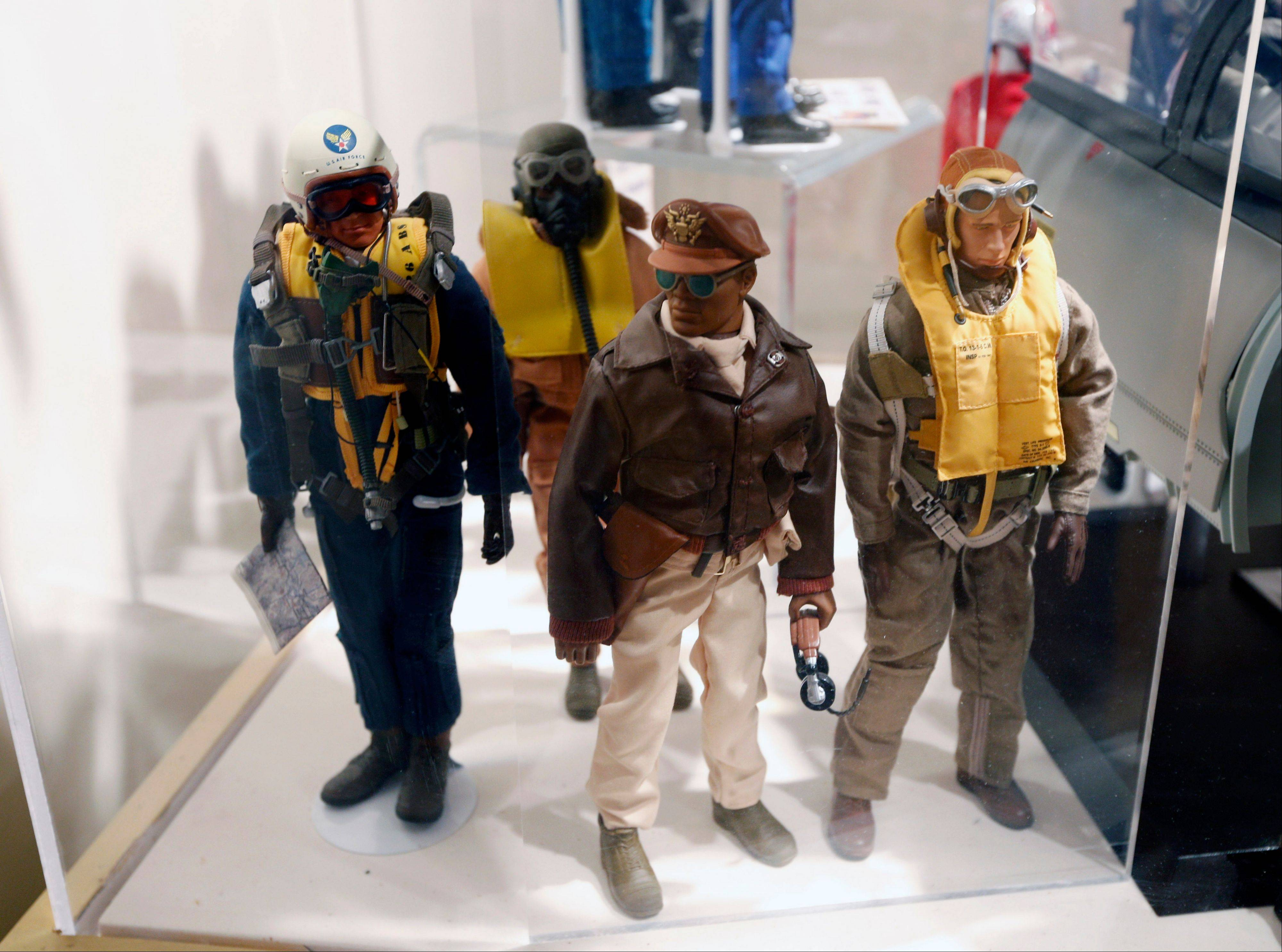 Tuskegee Airmen G.I. Joe action figures are seen in a display at the New York State Military Museum in Saratoga Springs, N.Y. A half-century after the 12-inch doll was introduced at a New York City toy fair, the iconic action figure is being celebrated by collectors with a display at the military museum, while the toy's maker plans other anniversary events to be announced later this month.