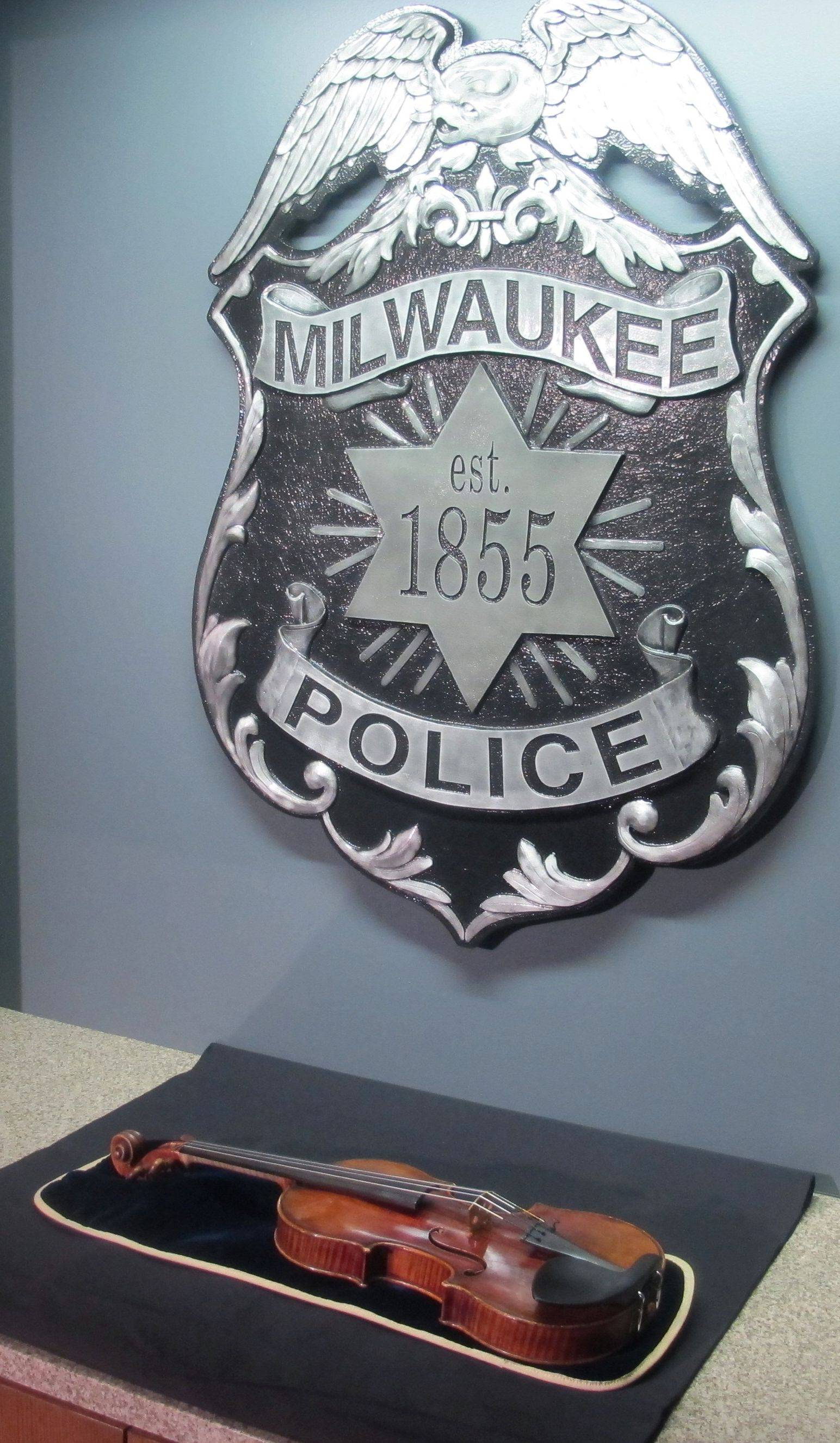 A $5 million Stradivarius violin is displayed at the Milwaukee Police Department Thursday.