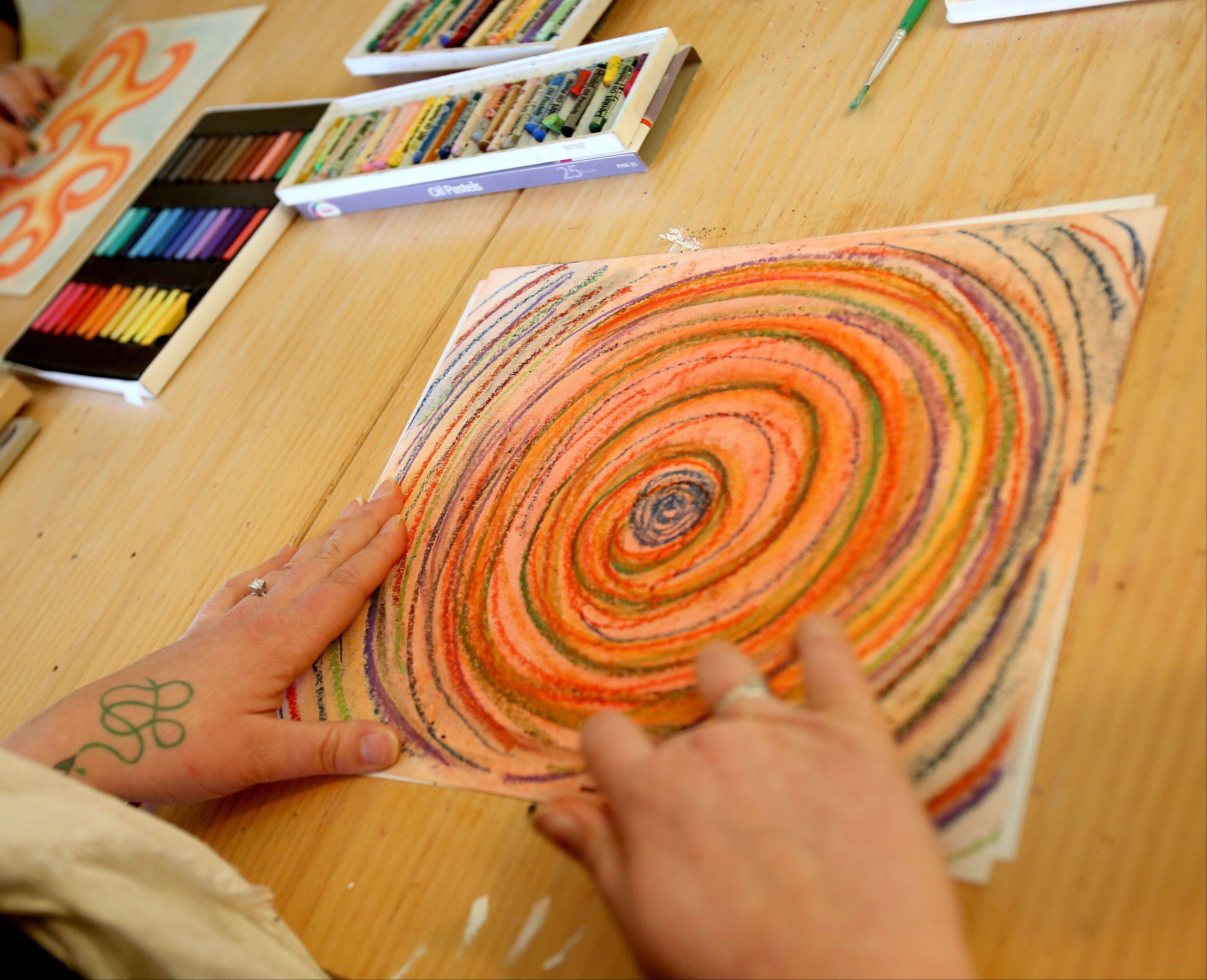 Melissa Hedlund works on a piece of art during a recent class.