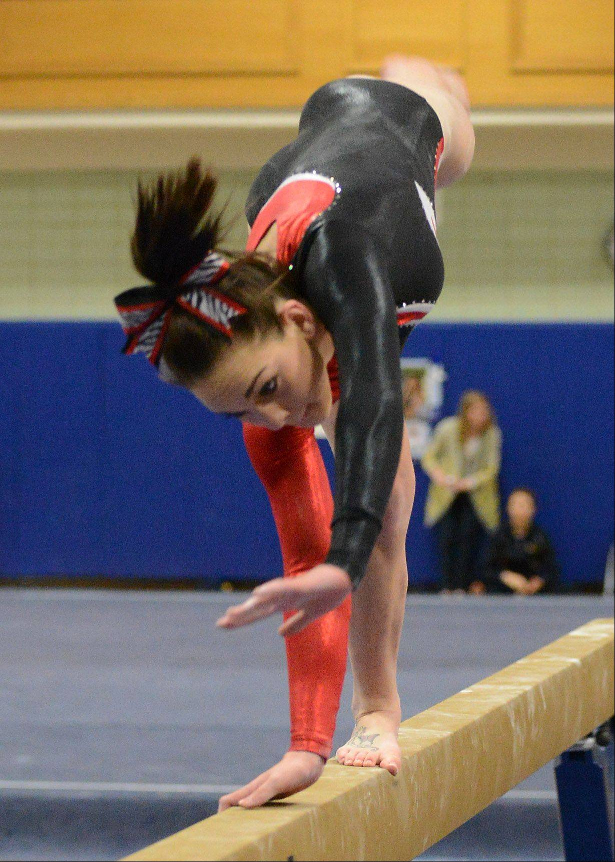 Alyssa Konkel of the U46 coop team starts her dismount on the balance beam during regional gymnastics action at Geneva High School Thursday.