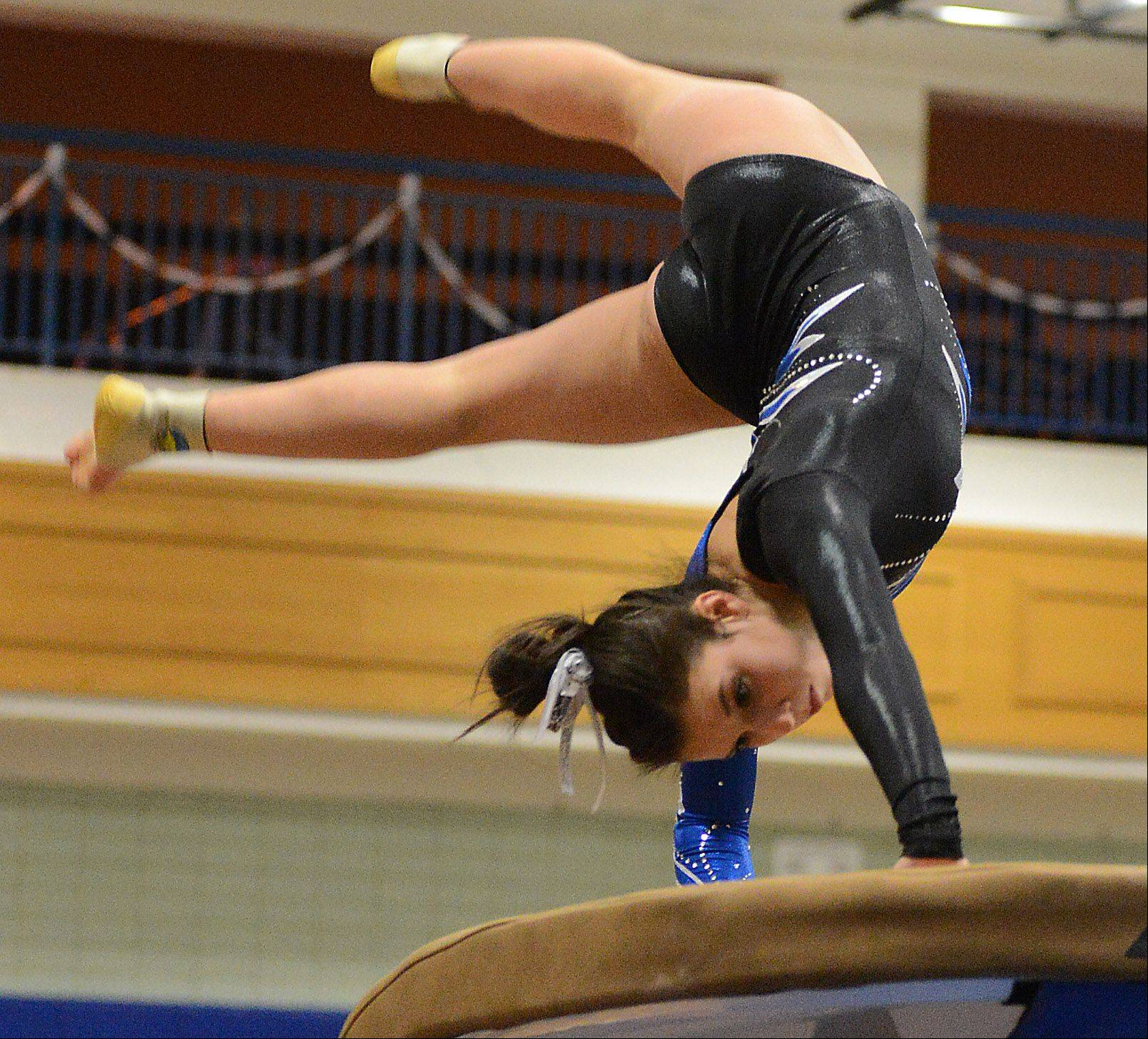 Geneva's Grace Ginsberg competes on the vault during regional gymnastics action at Geneva High School Thursday.