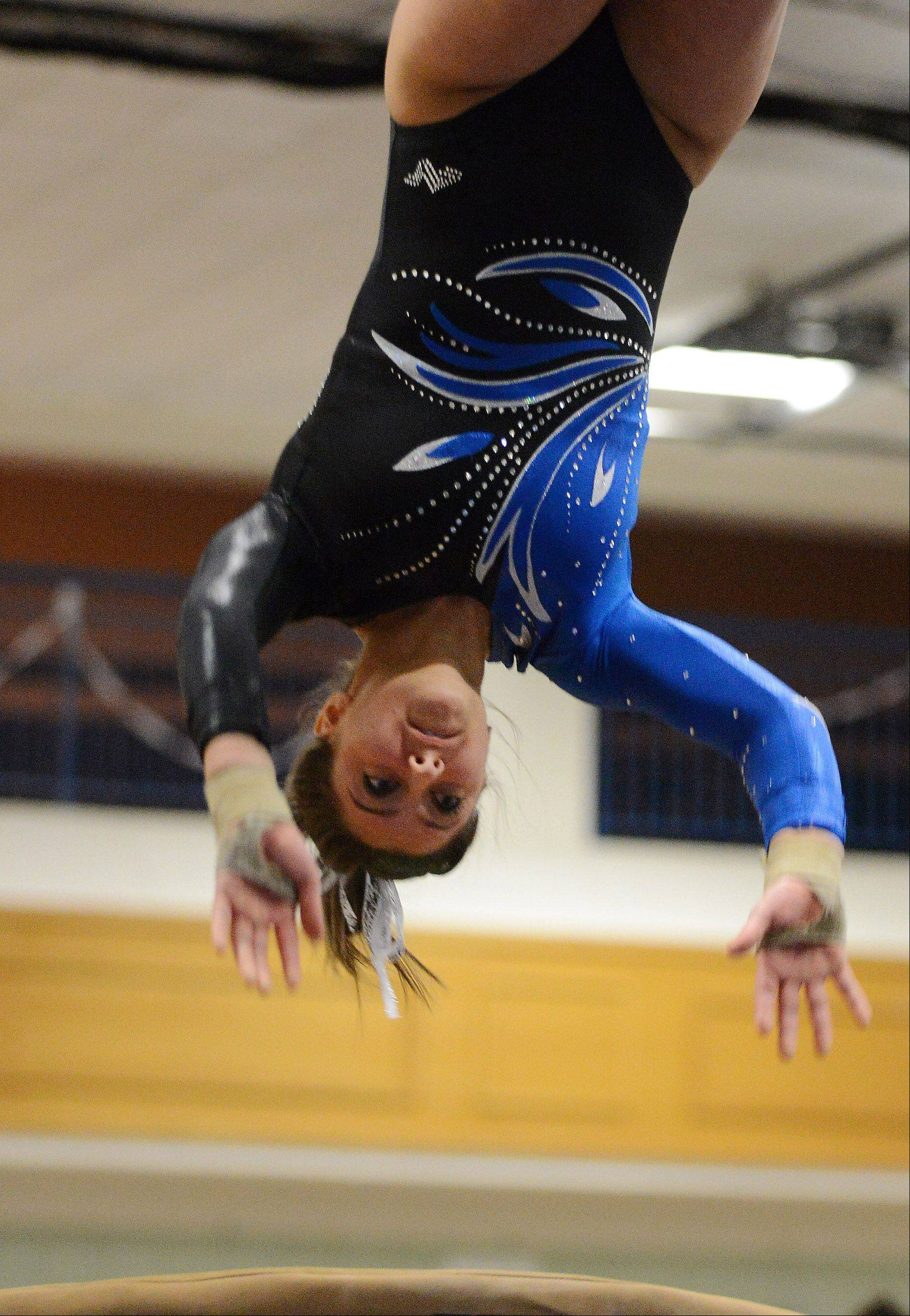 Geneva's Dominique Brognia competes on the vault during regional gymnastics action at Geneva High School Thursday.